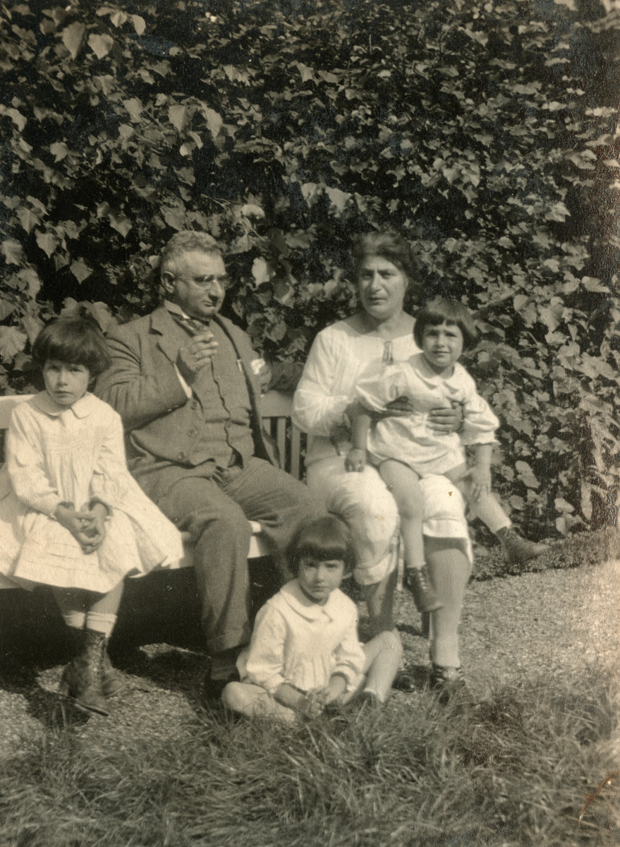 A Jewish family in Denmark rests in a park.  Pictured are Ferdinand Gruen, the oldest brother of Gertrud Oestermann, Gertrud and her three daughters: Else, Margot and Lilian.