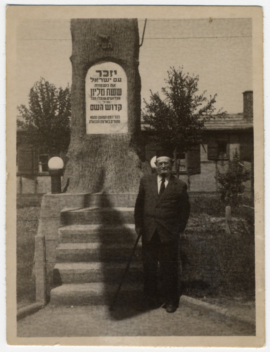 An elderly Jewish man stands in front of the memorial in the Ziegenhain displaced persons' camp to the six million martyrs of the nation of Israel.
