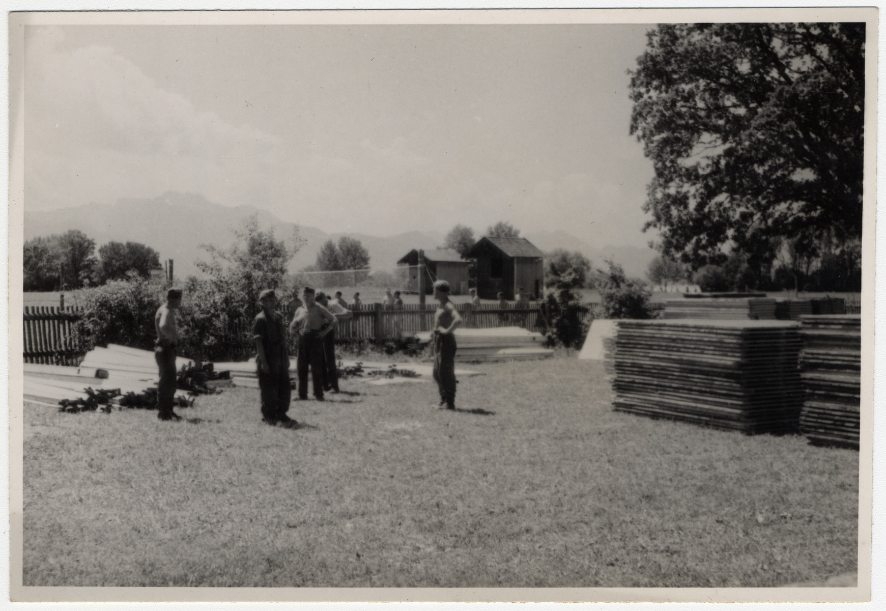German prisoners of war work in the yard of Chiemsee.