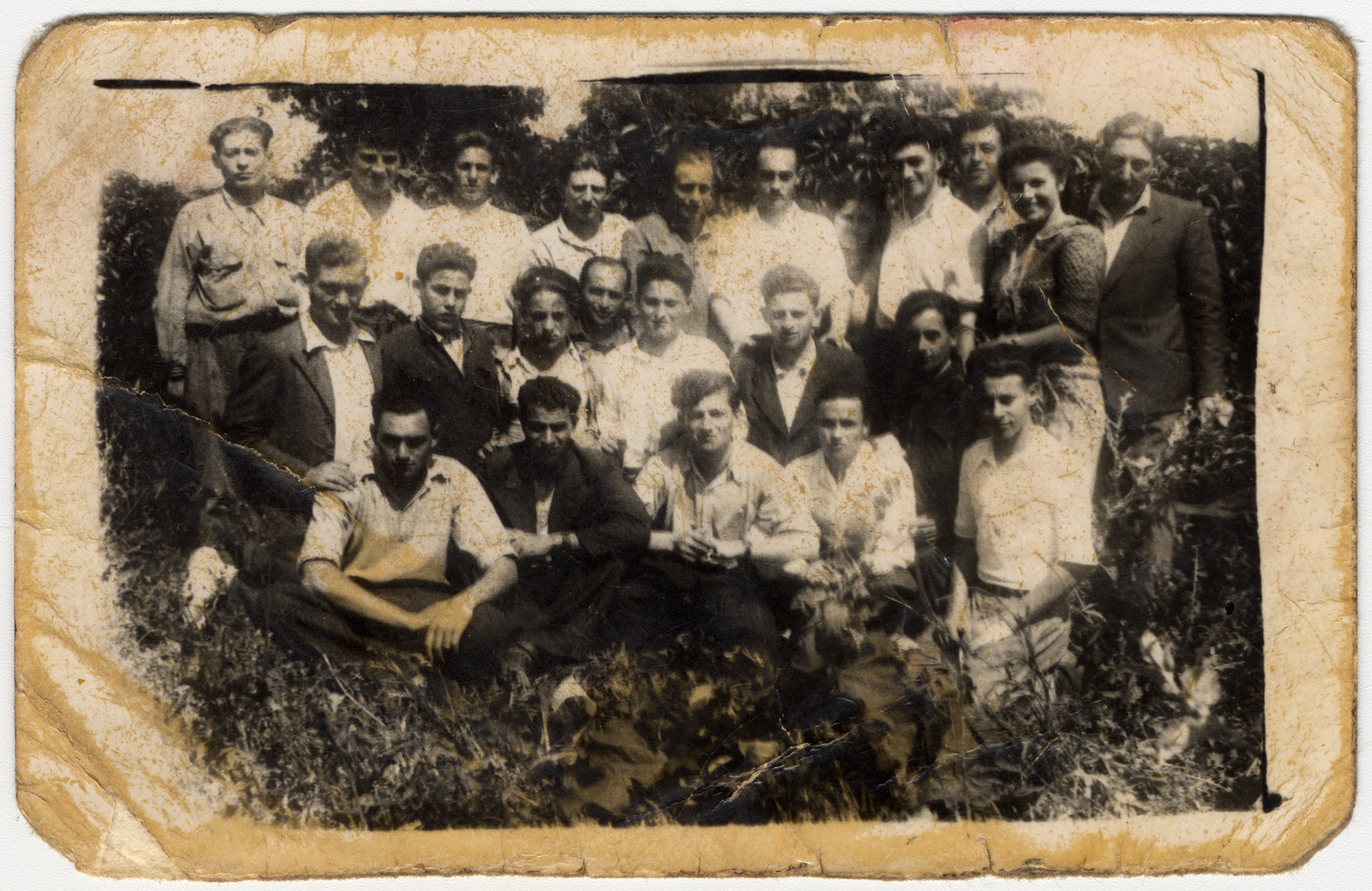 Group portrait of Polish survivors who are living temporarily in Szczecin before leaving for the west.  David Rynecki is pictured on the top left.