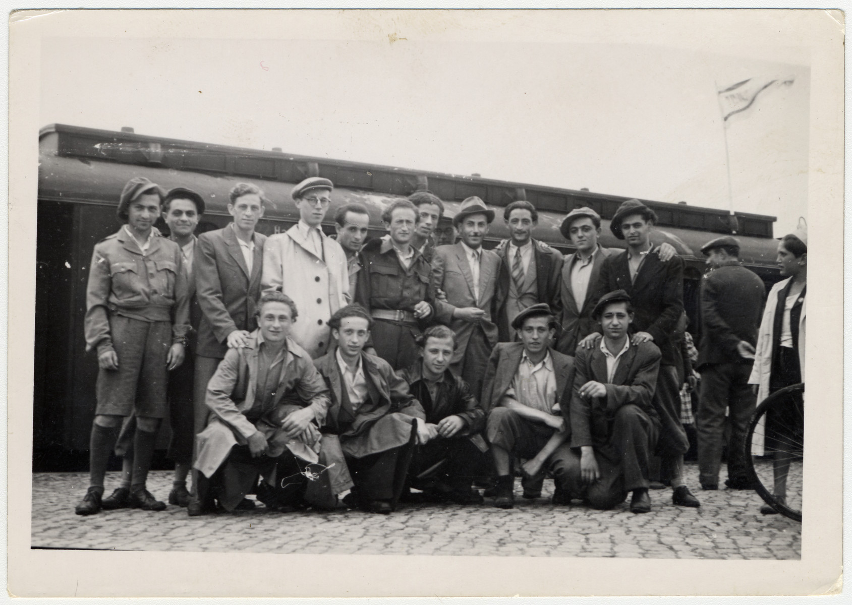 A group of Jewish men from the Bergen-Belsen displaced persons camp pose at the train station.