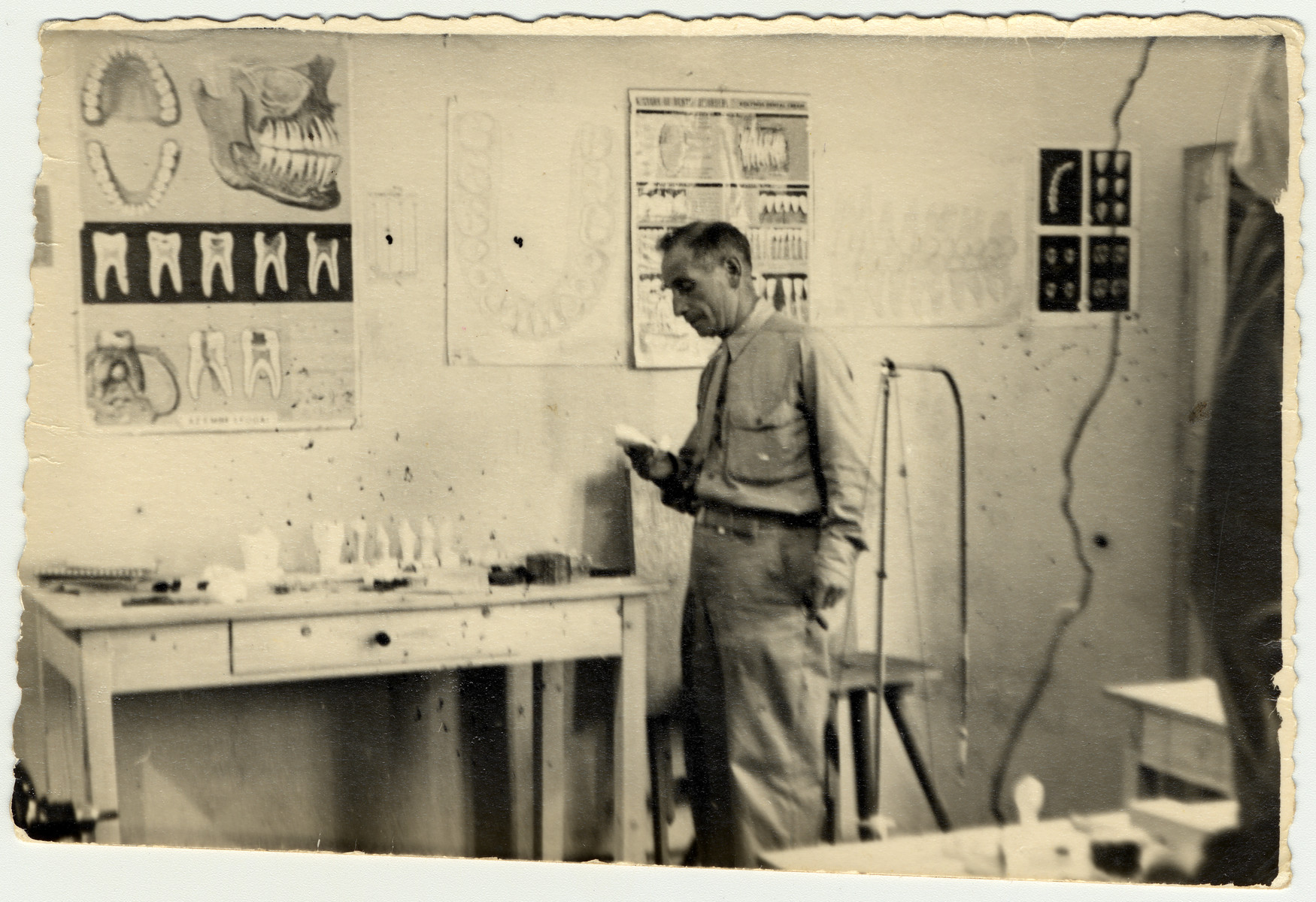 The instructor stands in his classroom in the ORT dental technician school in the Bergen-Belsen displaced persons camp.
