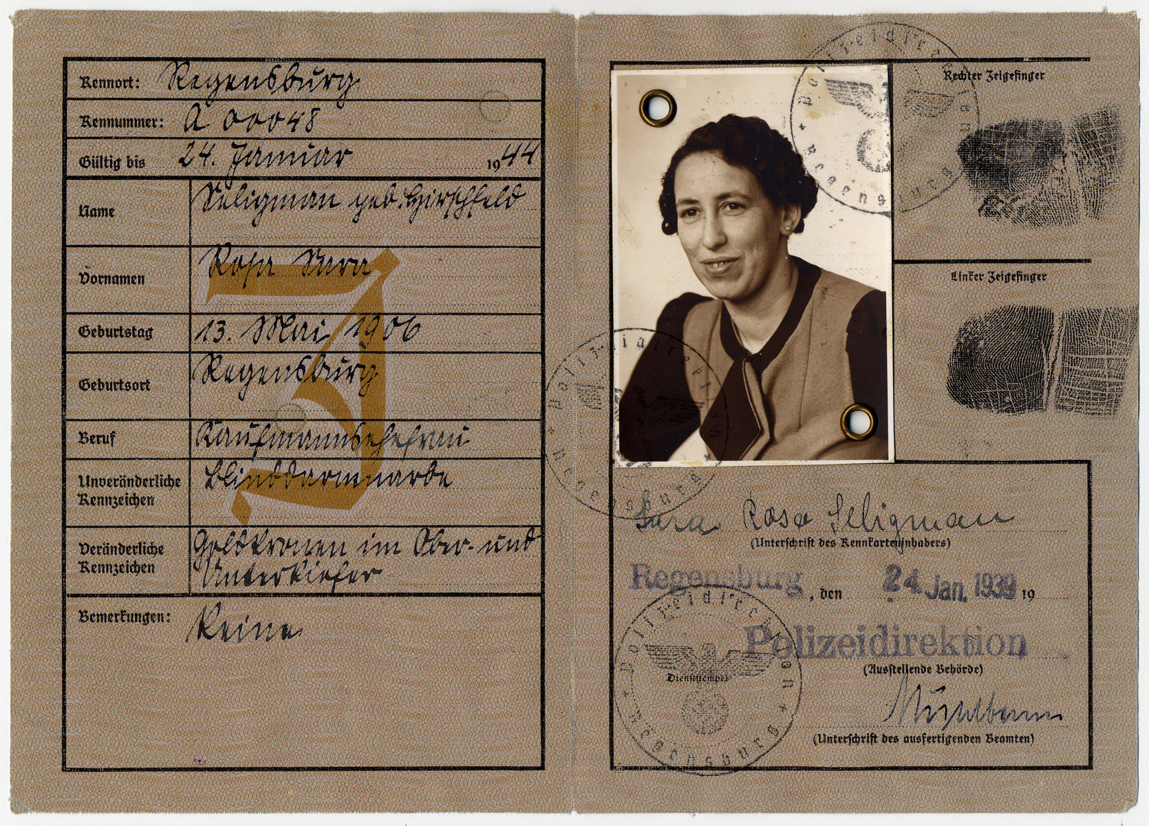 """Kennkarte issued to Sara Rosa Seligman, stamped with the letter J for """"Jude"""" (Jew)."""