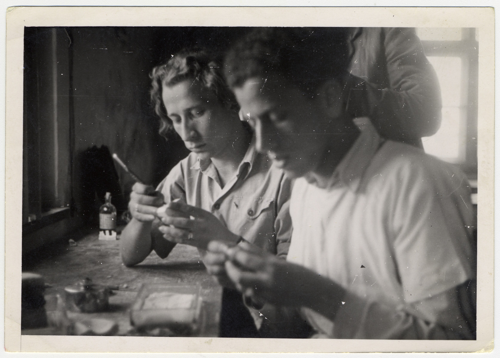 Two young men practice dentistry in the ORT dental technicians school in the Bergen-Belsen displaced persons camp.