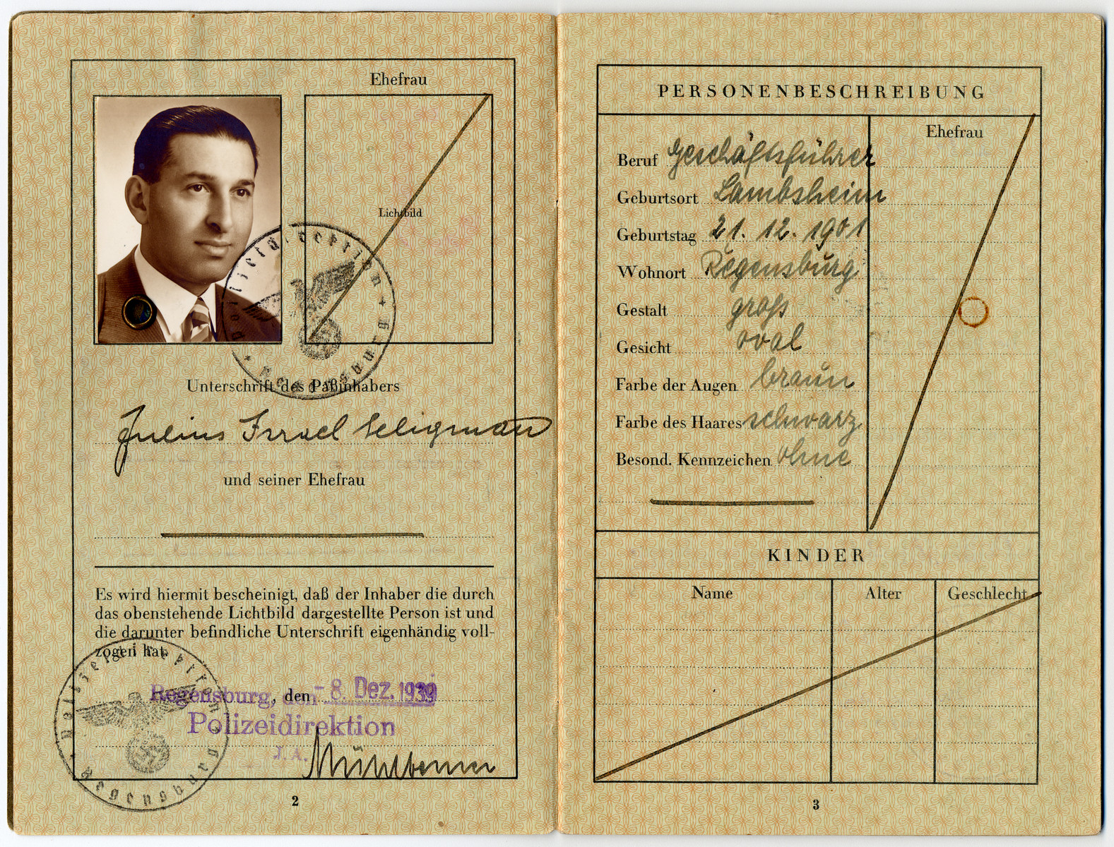"Reisepass issued to Julius Israel Seligman, containing a stamp of the letter J for ""Jude"" (Jew) on the first page."