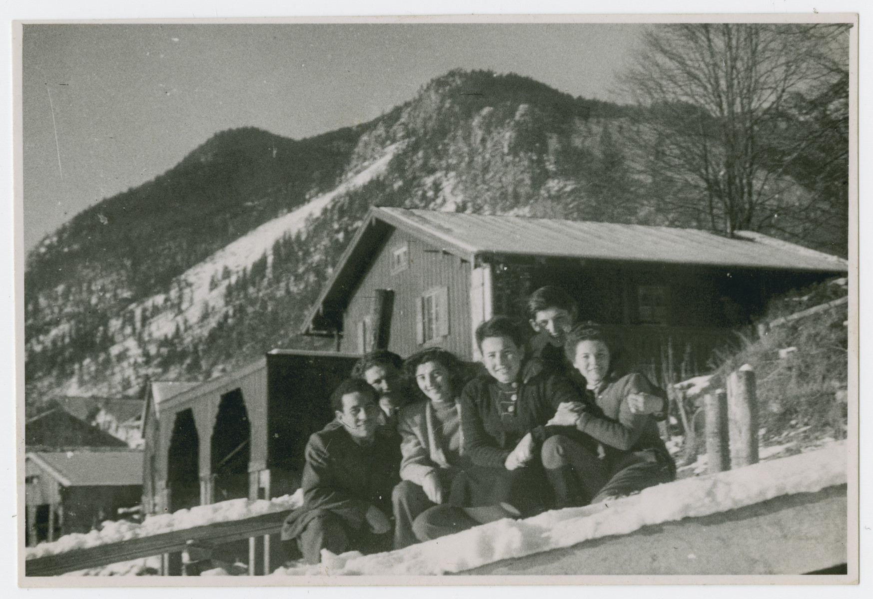 Young people [perhaps from the Eggenfelden displaced persons camp] pose by a mountain chalet.