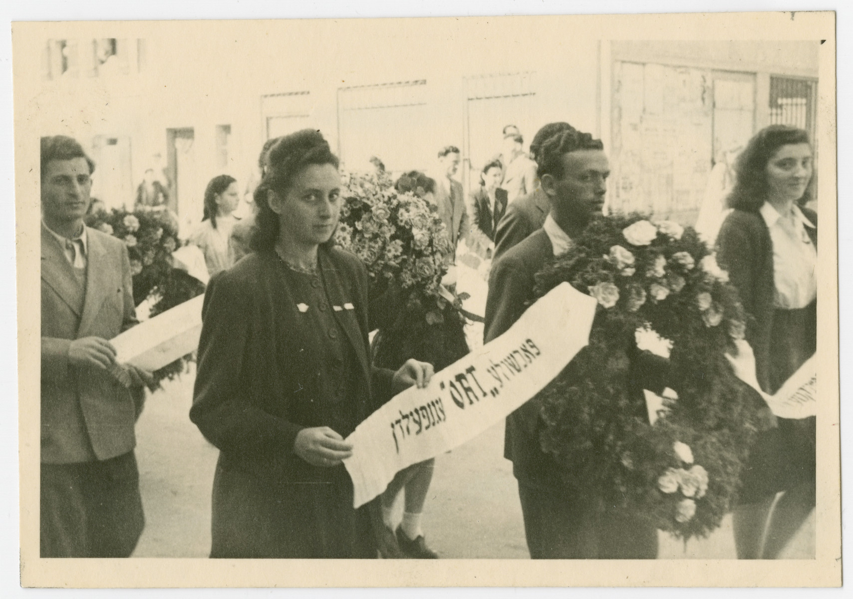 Jews from the Eggenfelden displaced persons camp participate in a commemorative march for the victims of a Nazi death march.  Vera Spitz is pictured on the far right.