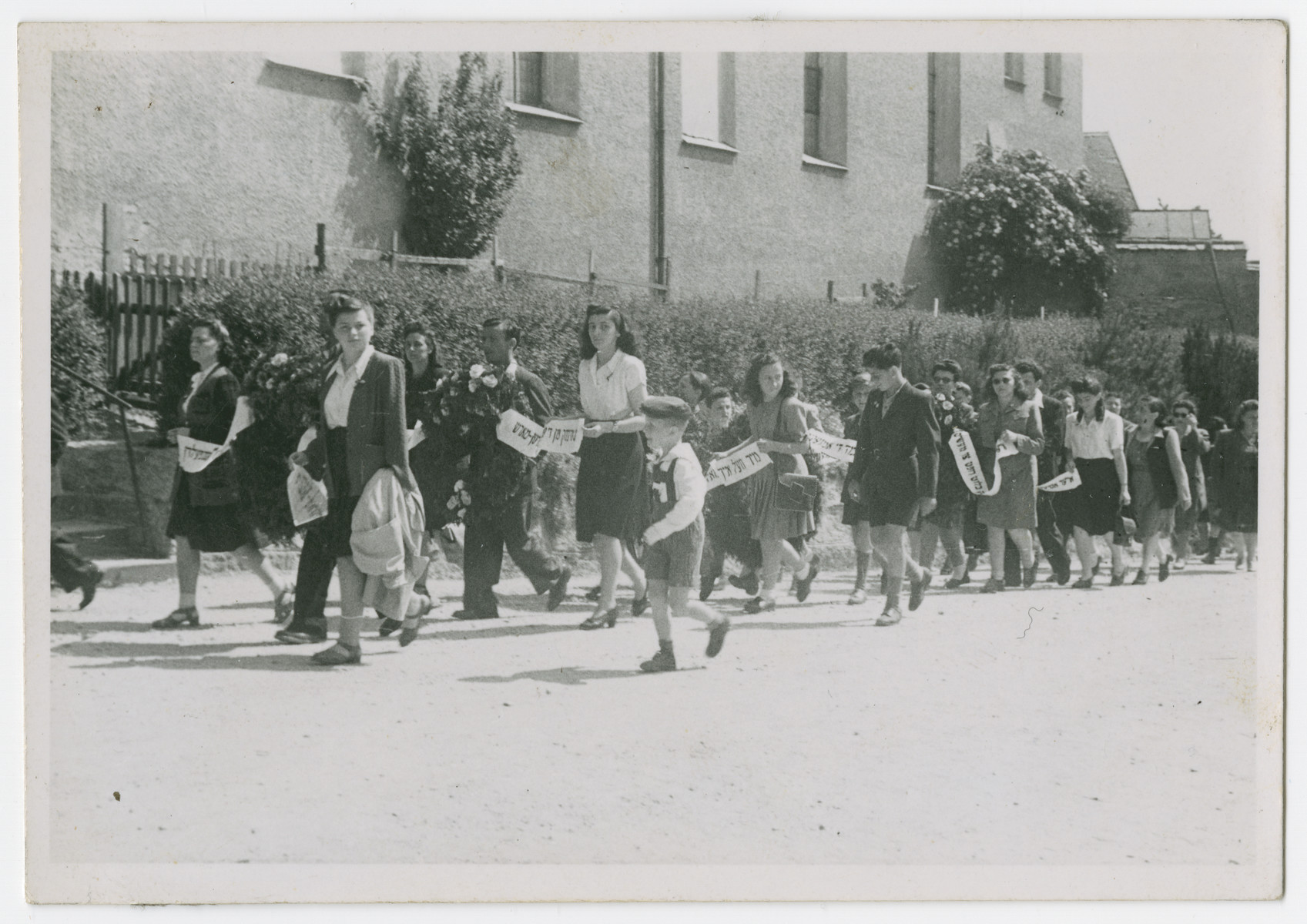 Jews from the Eggenfelden displaced persons camp participate in a commemorative march for the victims of a Nazi death march.