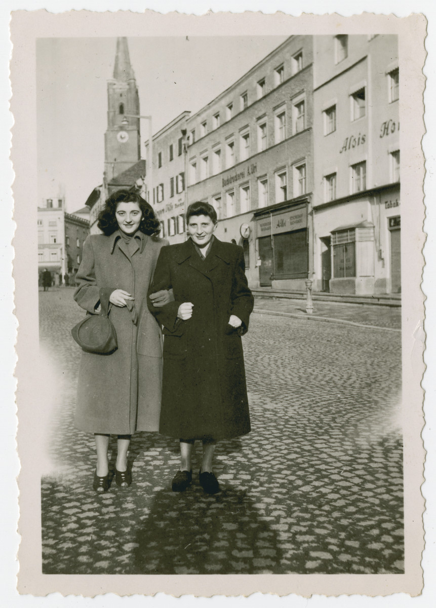 Vera Spitz and her mother Irene walk down a street in Bavaria.