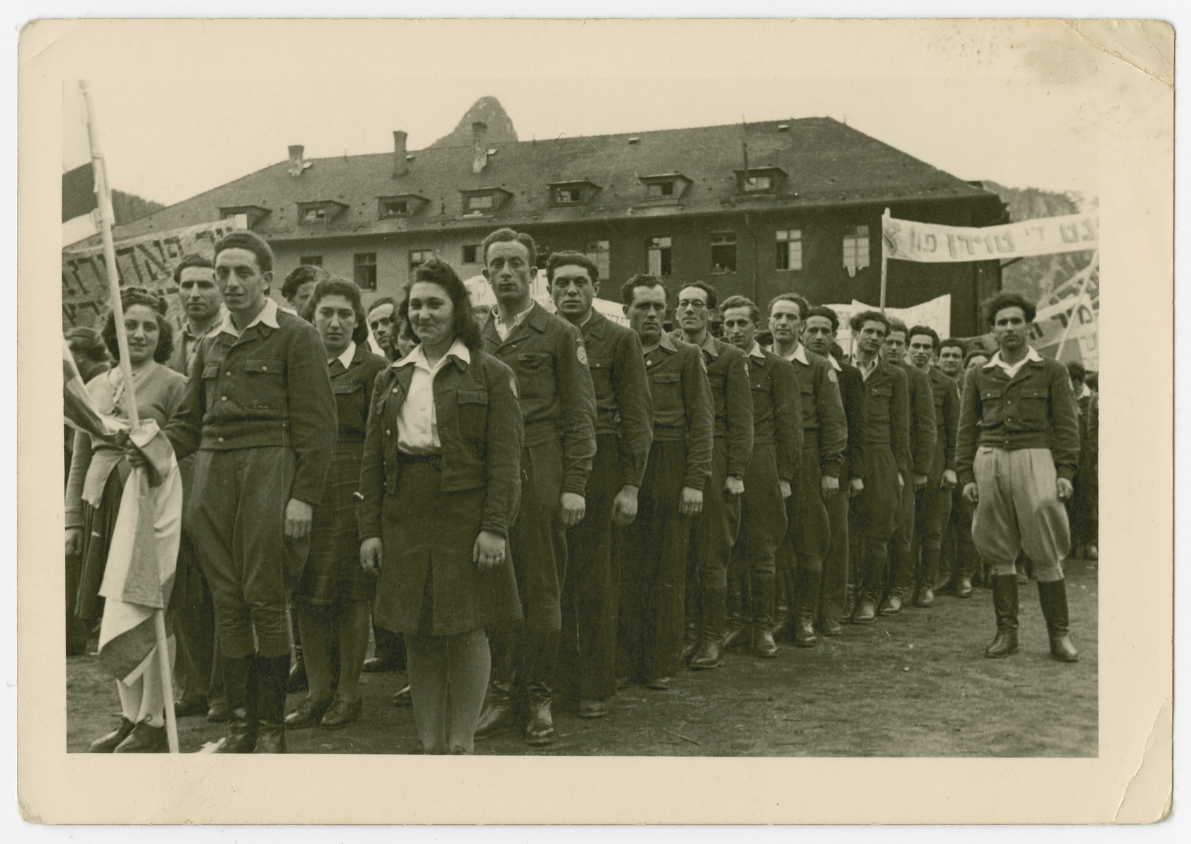 Jewish men and women stand in a line for a demonstration in the Bad Reichenhall displaced persons camp.
