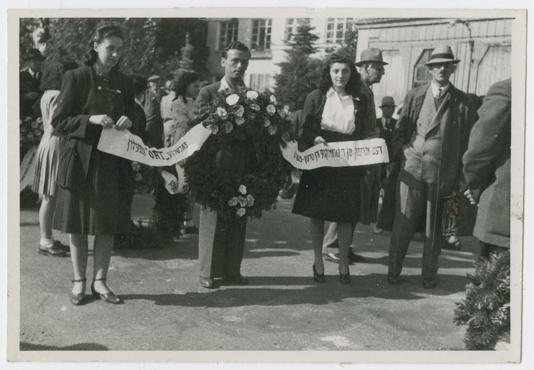 Jews from the Eggenfelden displaced persons camp participate in a commemorative march for the victims of a Nazi death march.  Vera Spitz is pictured third from the left.