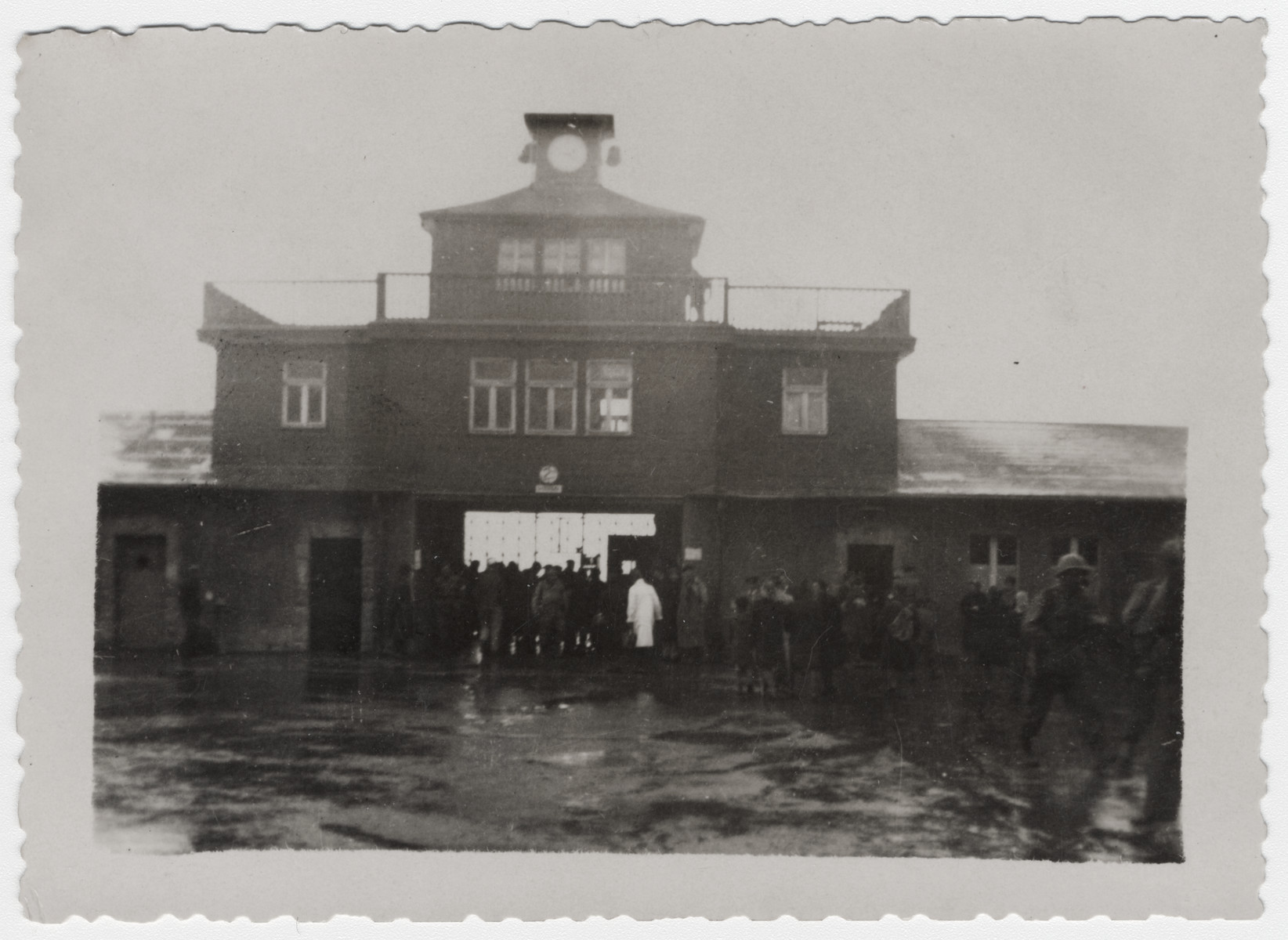 American soldiers enter the main gate to the Buchenwald concentration camp.