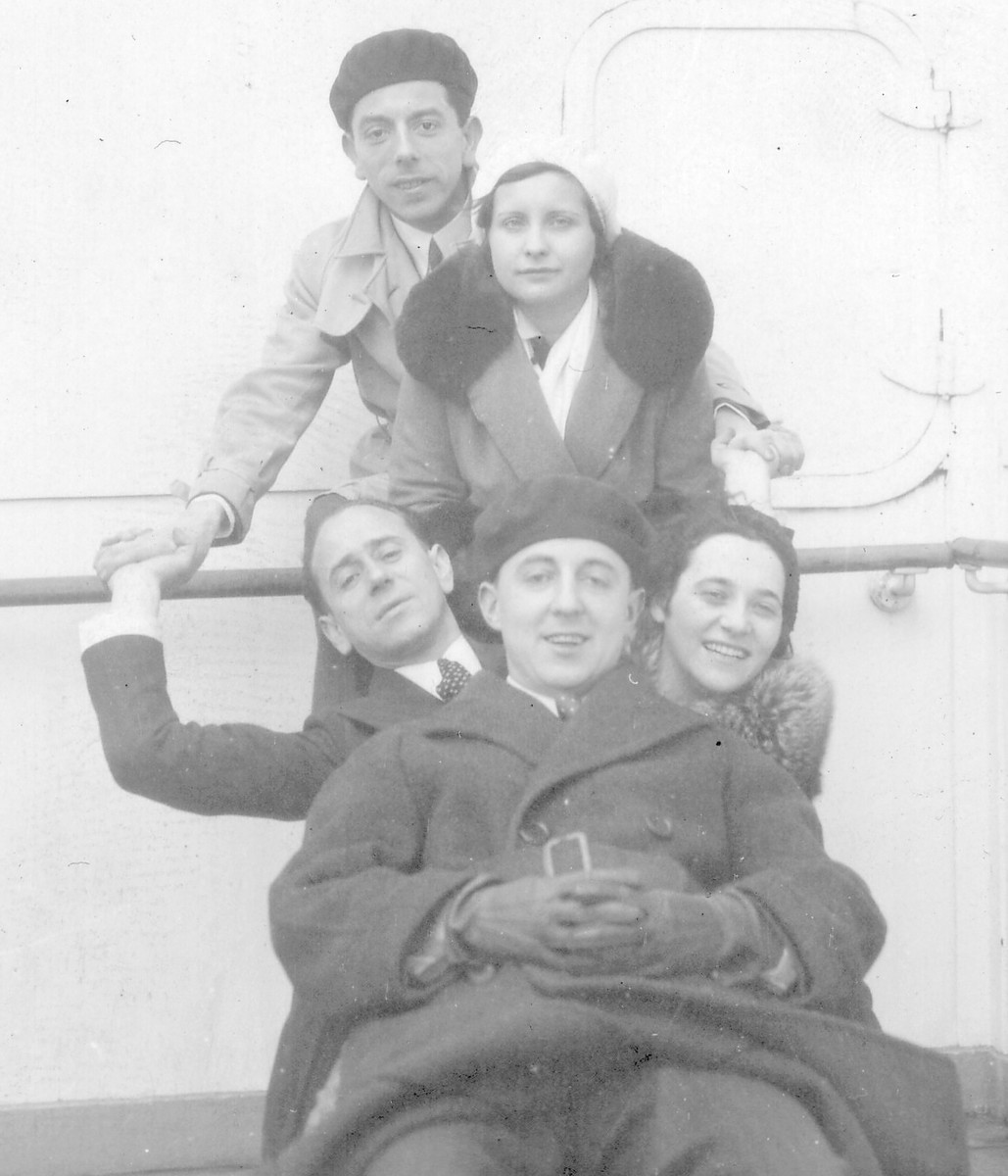 Lily Weinlaub and a group of her friends pose together on the deck of the SS Europa en route home to the United States.