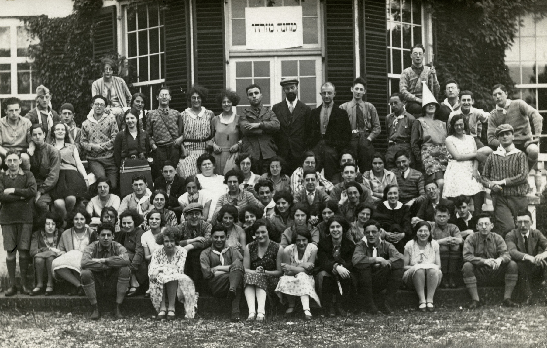Religious Zionist teenagers pose for a group portrait in a Mizrachi, summer camp.