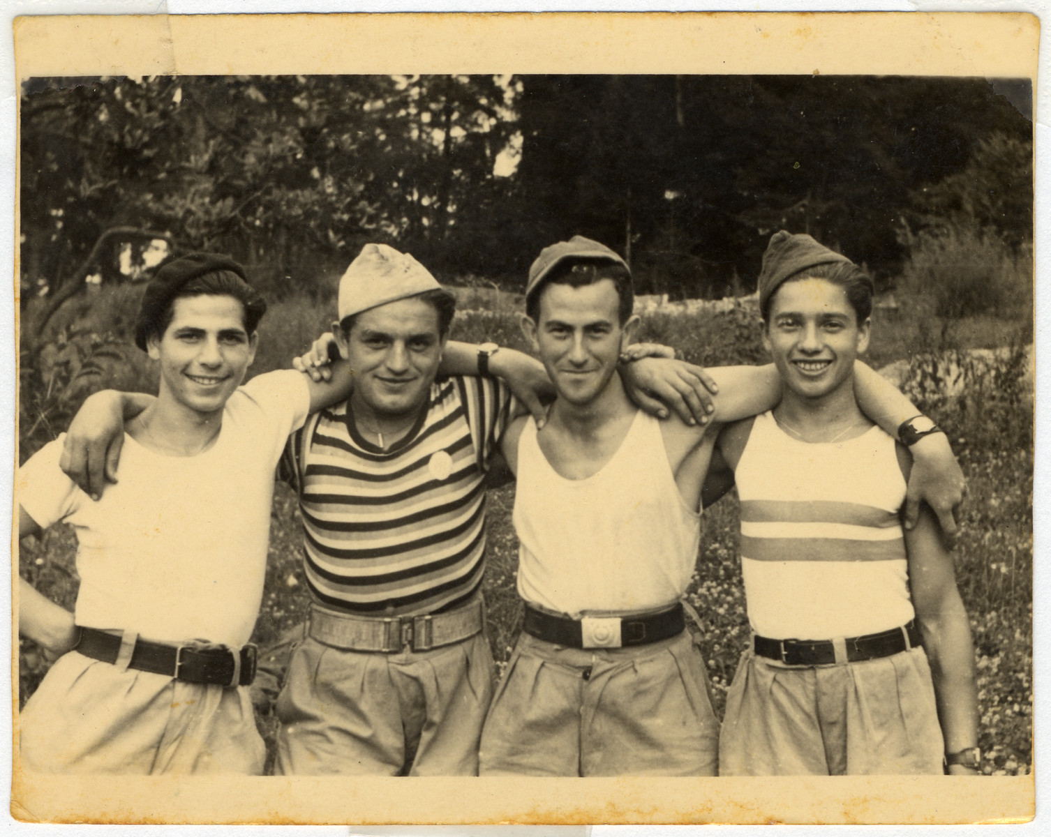 Group portrait of displaced persons in Kibbutz Mekor Baruch, a Poal Mizrachi fishing hachshara in Bacoli, Italy.  Pictured from left to right are Eliezer Majerovic, Aryeh Bein Horin, Yaakov Gutman and Meir (Miki) Weiss.