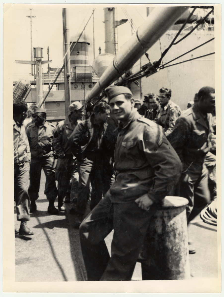 Gerald Liebenau, an American Jewish soldier born in Germany, poses on a troop ship on his way back to the United States.