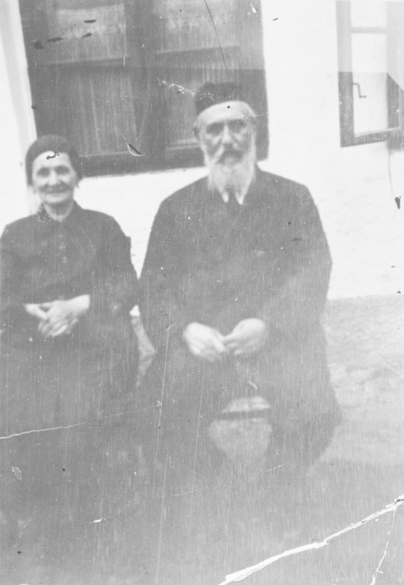 Close-up portrait of Moshe Aaron and Ottilia Schwarz outside their home.