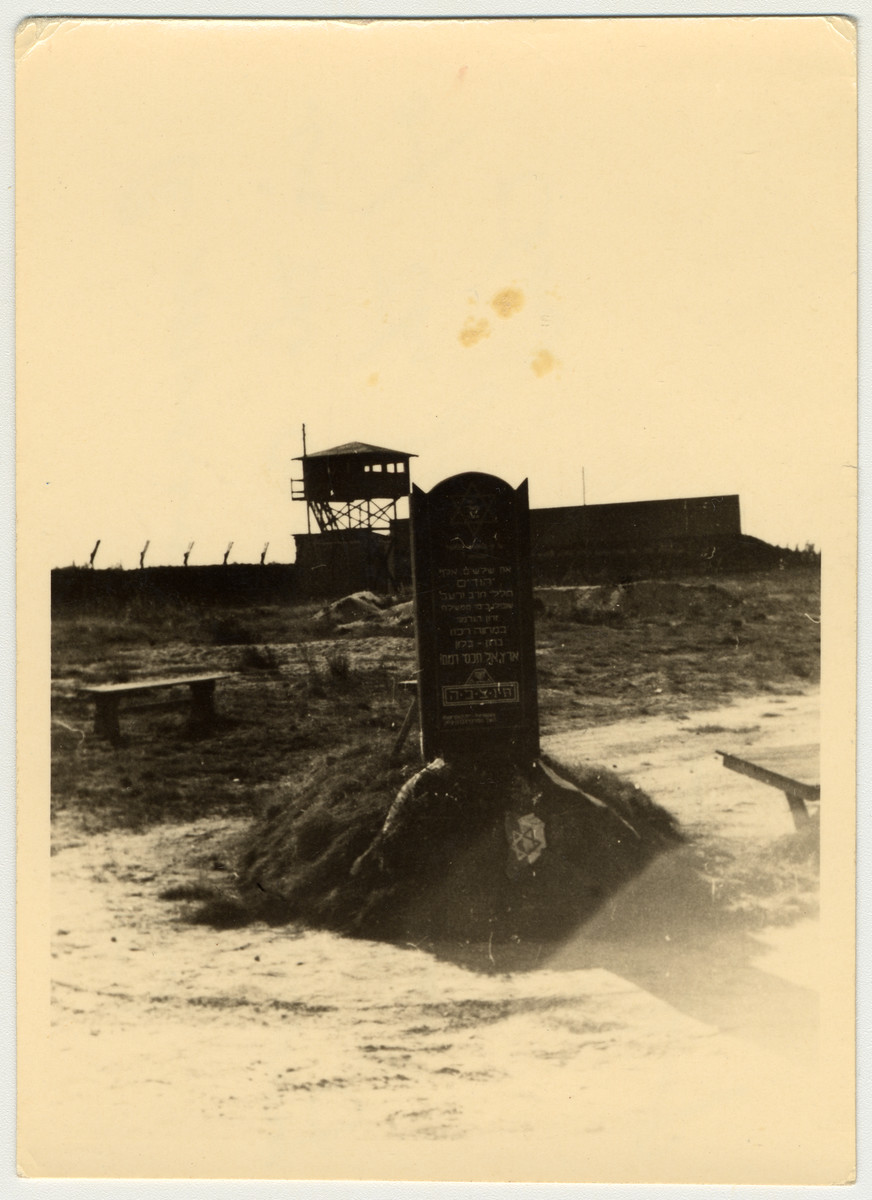 "View of a monument/tombstone placed in Bergen-Belsen after the liberation on April 15, 1945 in memory of Jewish victims..  The original caption states, ""A monument erected in the camp in memory of the Jews who died there."""