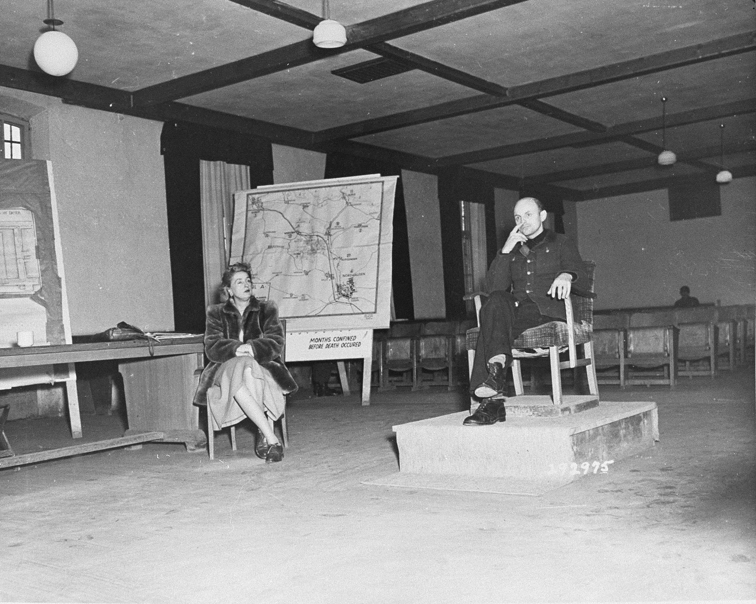 Former SS Colonel Gerhard Maurer testifies for the defense at the trial of former camp personnel and prisoners from Dora-Mittelbau. To the left is Emily Polyn-Cobb, an interpreter.