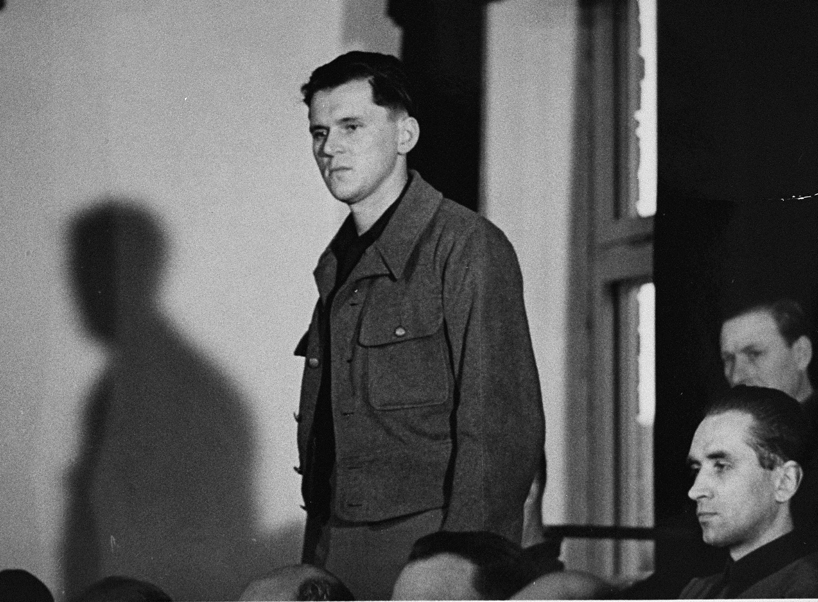 Willi Eckert stands in his place in the defendants' dock at the trial of 61 former camp personnel and prisoners from Mauthausen.