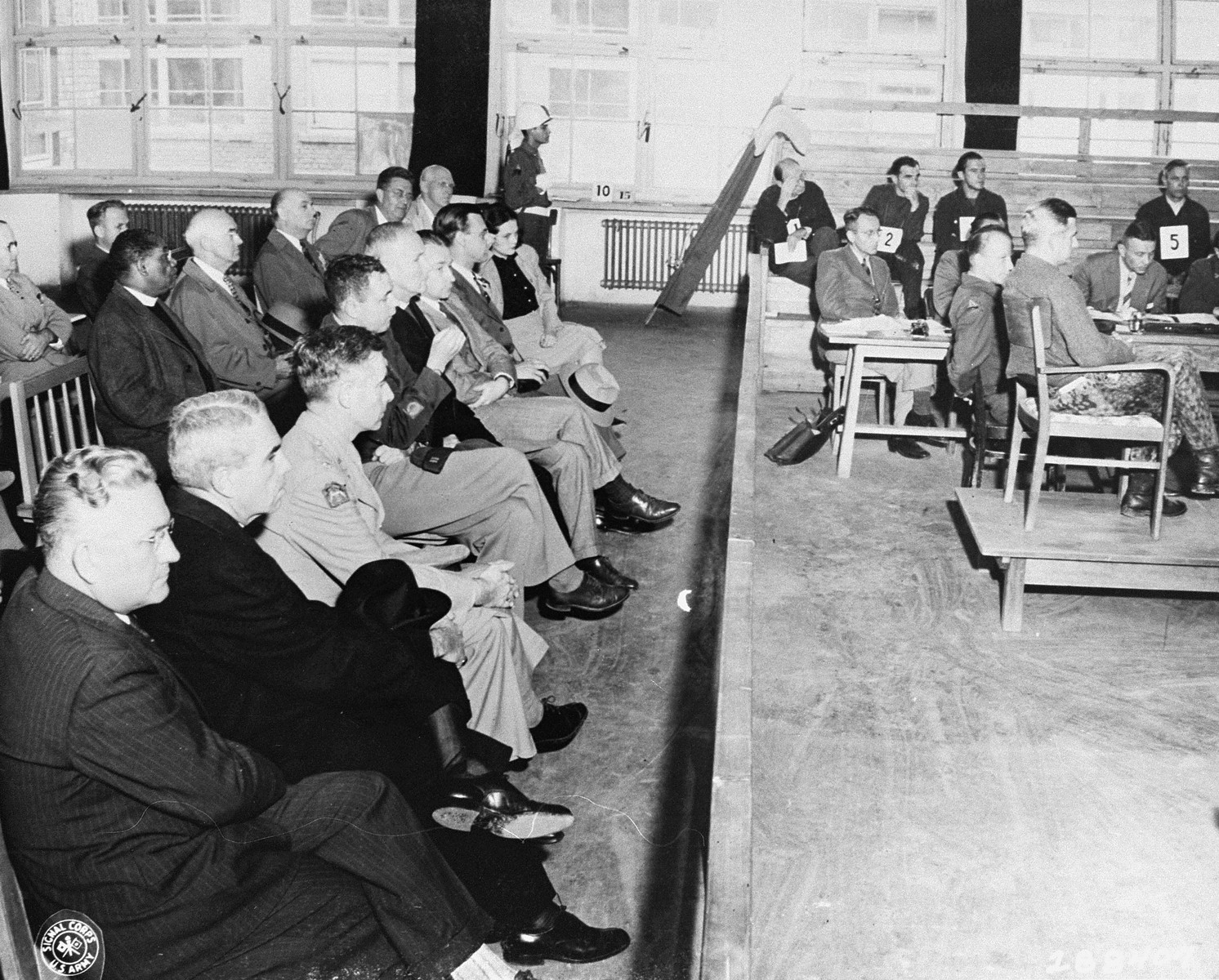 A group of fourteen American clergymen (left) attend the trial of former camp personnel and prisoners from Buchenwald during their tour of camp sites in 1947.