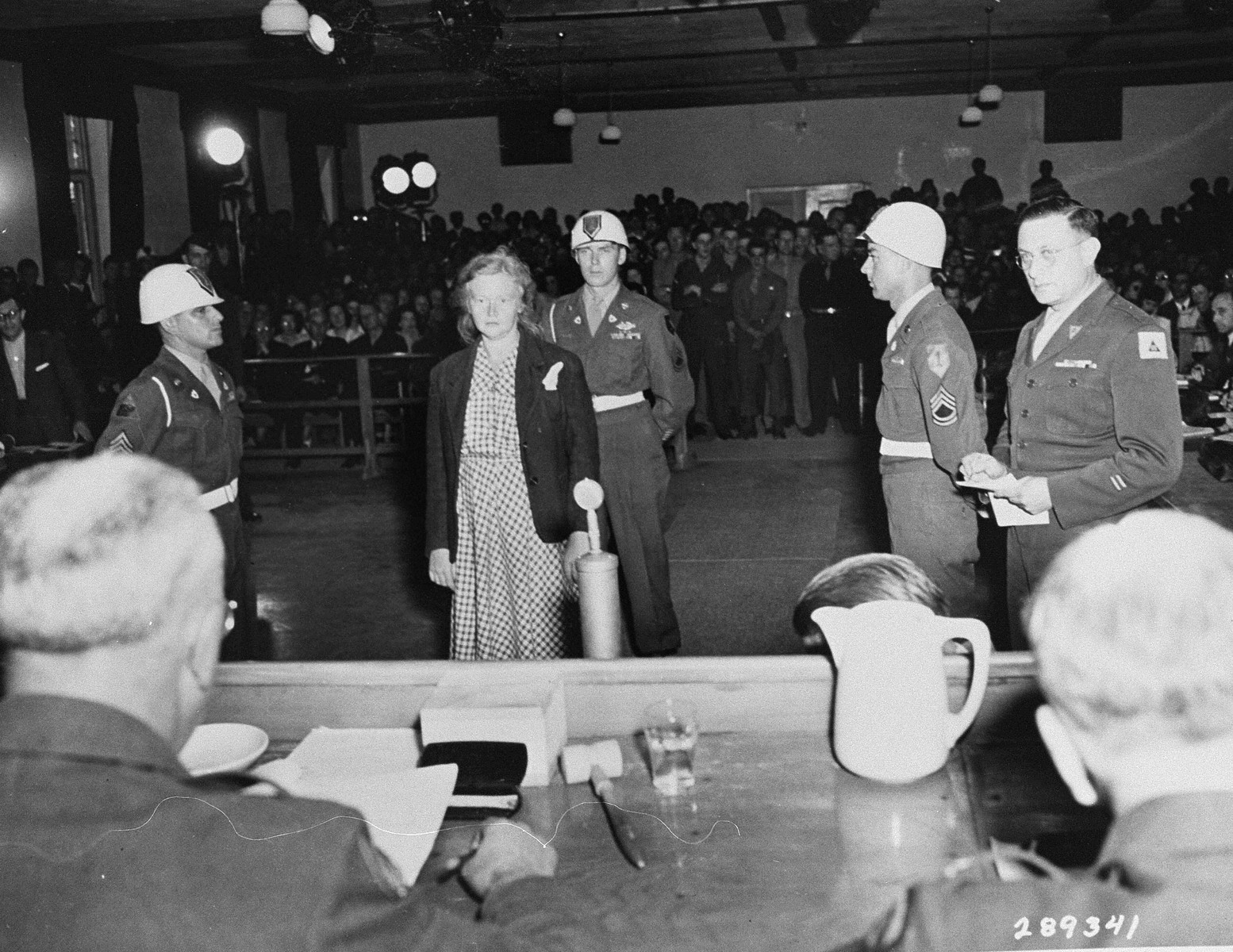 Ilse Koch is sentenced to life in prison by Brigadier General Emil C. Kiel (back to camera) at the trial of former camp personnel and prisoners from Buchenwald.