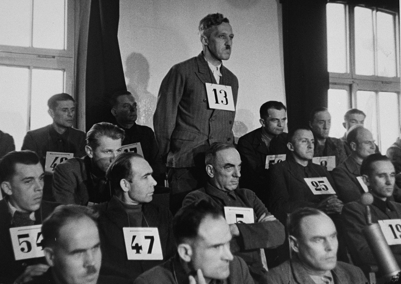 August Eigruber, former Gauleiter of Upper Austria, and a defendant at the trial of 61 former camp personnel and prisoners from Mauthausen, stands in his place in the defendants' dock.   Eigruber was convicted and sentenced to death on May 13, 1946.