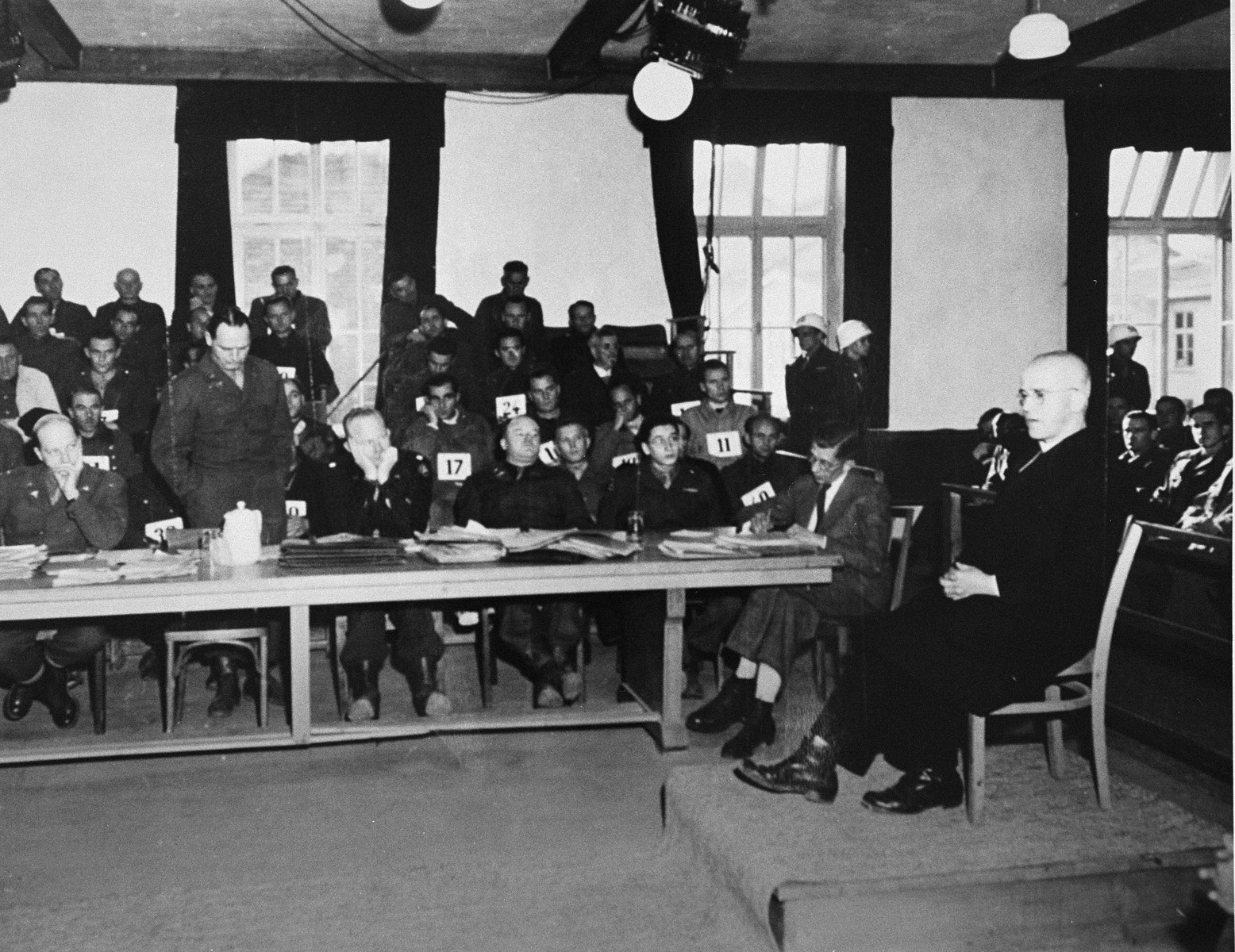 Father Johann Maria Lenz, a former inmate of Dachau, testifies at the trial of former camp personnel and prisoners from Dachau.    Lenz was commissioned by the Vatican to write a book about the camp.
