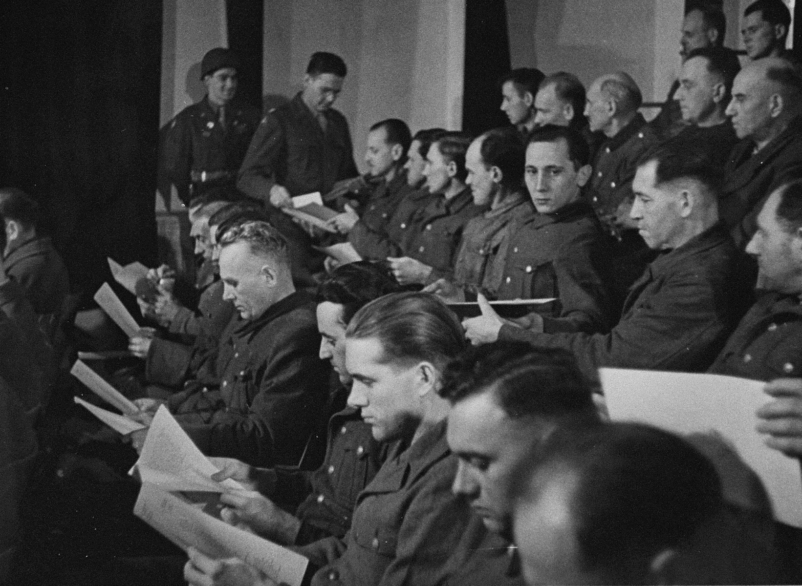 The defendants receive the indictments against them at the trial of 61 former camp personnel and prisoners from Mauthausen.
