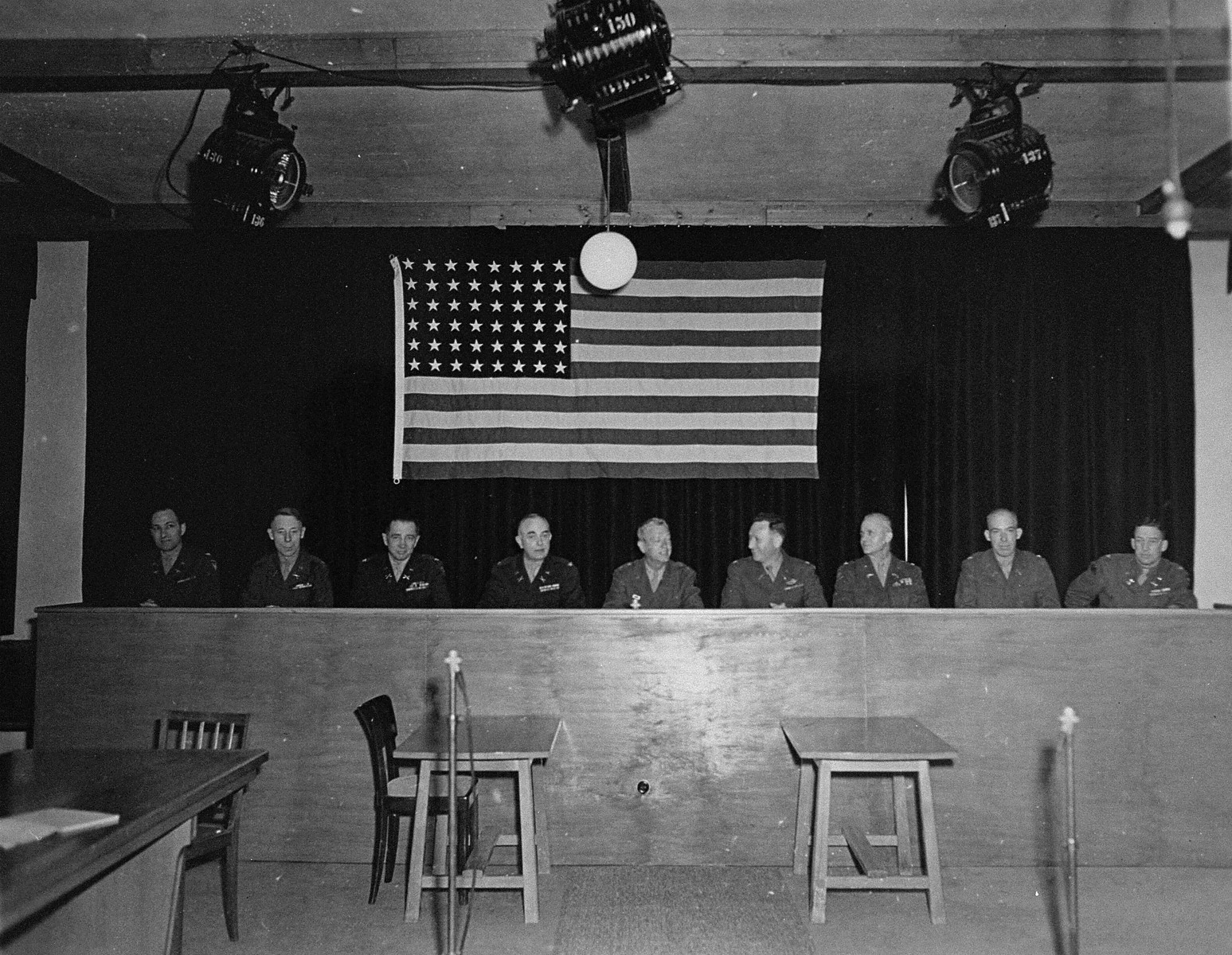The American Military Tribunal hearing the trial of 61 former camp personnel and prisoners from Mauthausen.  In the middle is the Tribunal's president, Major General Fay Brink Prickett.
