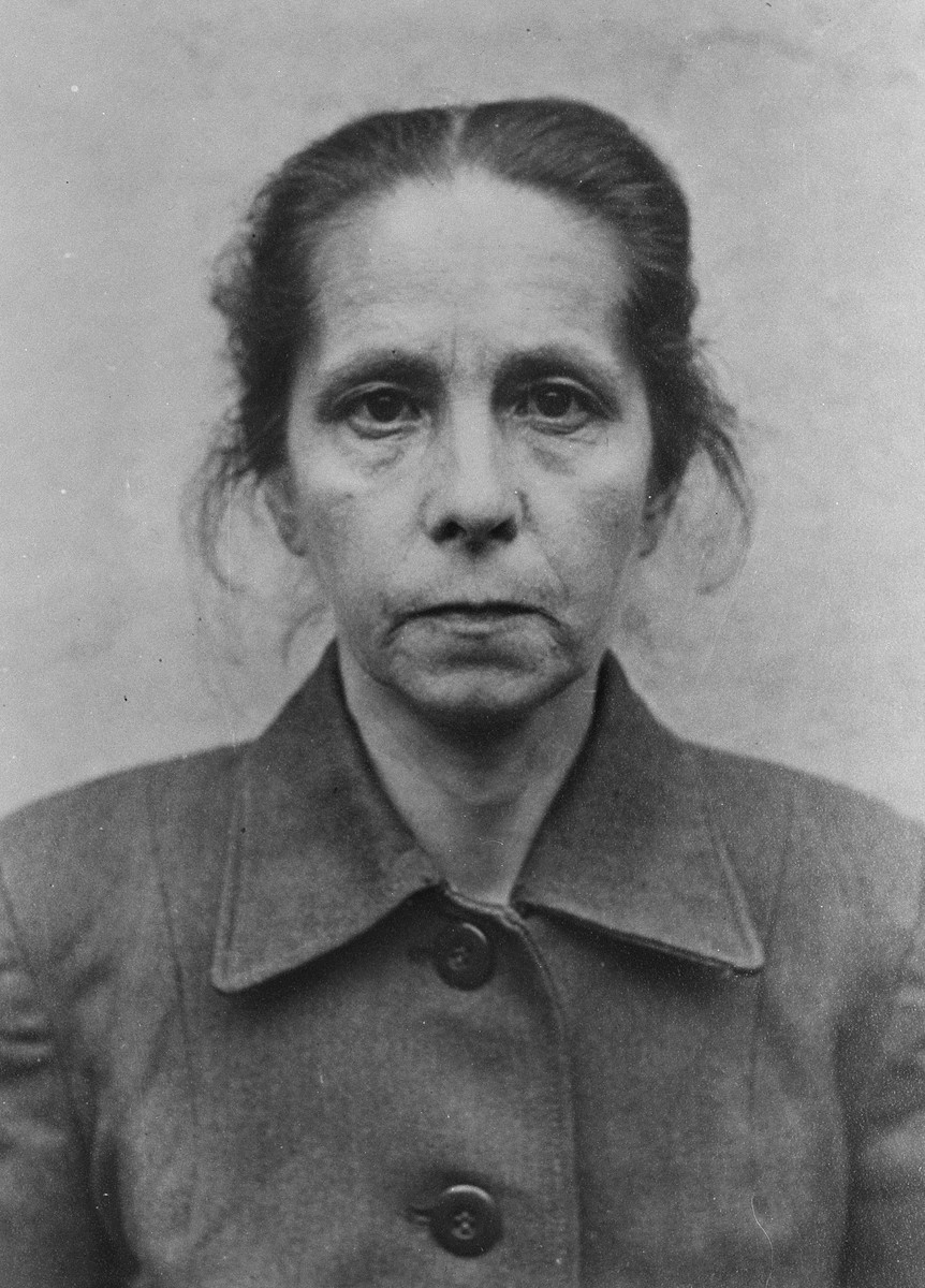 Juana Bormann, part of a series of mug shots taken of former guards and prisoners from the Belsen camp before their trial in front of a British Military Tribunal.    One of the oldest SS staff members in Bergen-Belsen at age 52, Juana Bormann had a reputation as a sadist.  Witnesses constantly repeated how at Auschwitz she would set her dog upon prisoners and watched as they were torn apart.  Questions of her sanity arose during the Bergen-Belsen Trial but they were not enough to keep her from being found guilty by the British Military Tribunal.  She was sentenced to death and hanged on 13 December 1945 in Hameln, Germany.