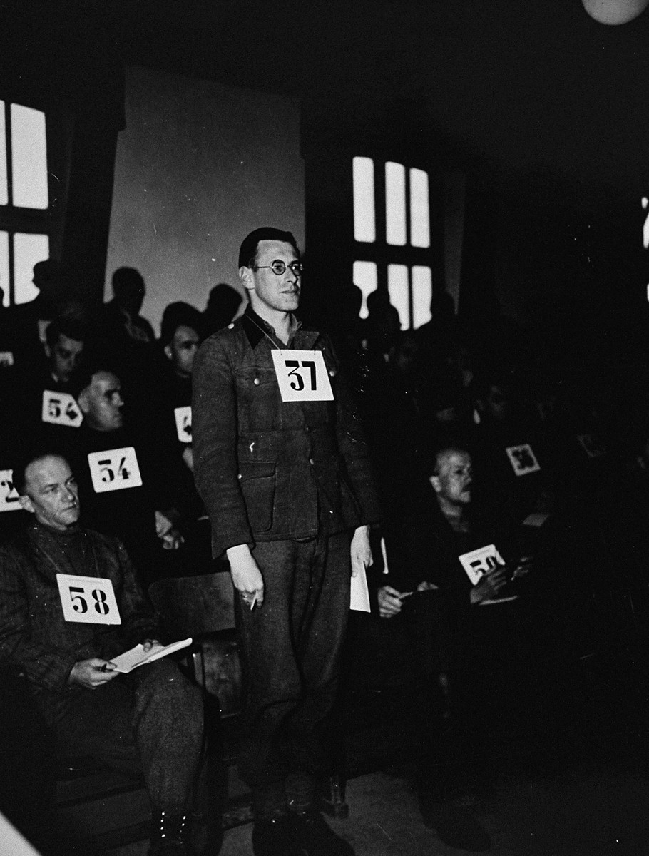 Former SS-Unterscharfuehrer Josef Leeb, a defendant at the trial of 61 former camp personnel and prisoners from Mauthausen, stands in his place in the defendants' dock.    Leeb was convicted and sentenced to death on May 13, 1946.