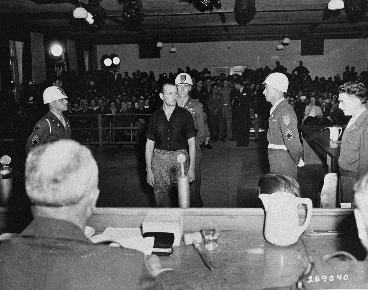 Former SS Sergeant Helmut Roscher is sentenced to death by hanging by Brigadier General Emil C. Kiel (back to camera) at the trial of former camp personnel and prisoners from Buchenwald.