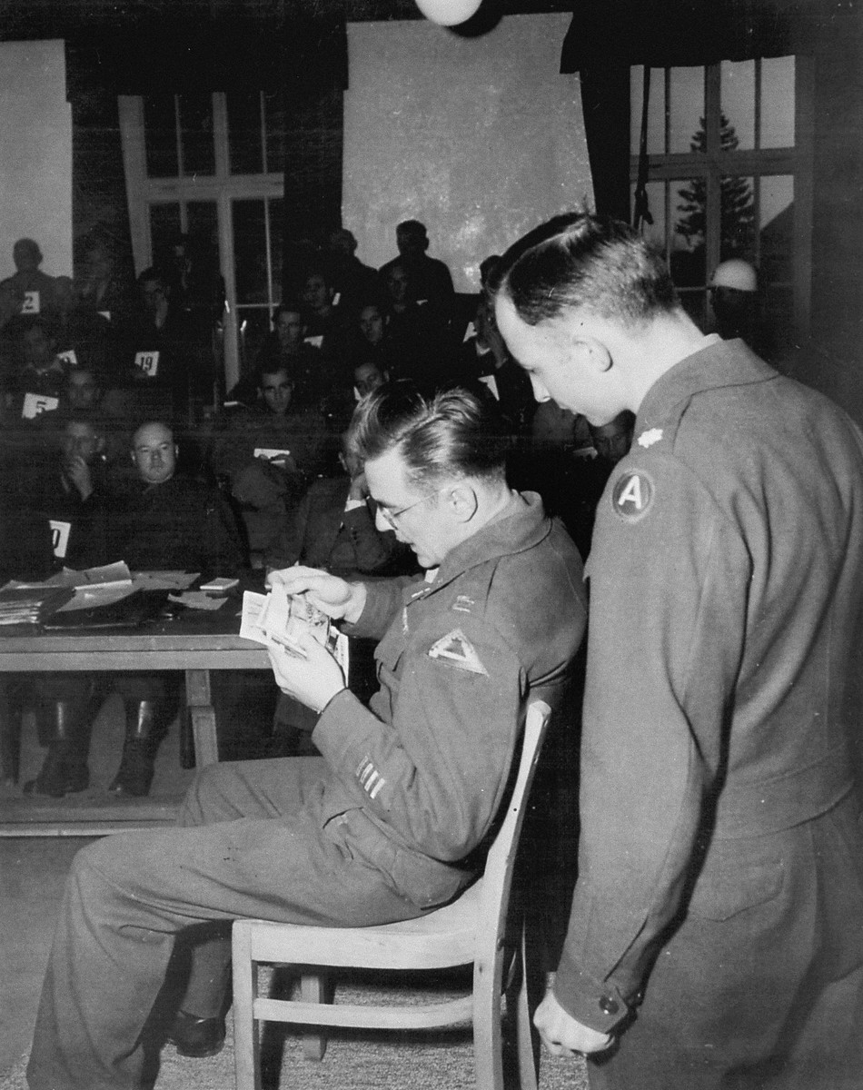 Capt. John Barnett testifies to the authenticity of photos taken when his troops overran the Dachau concentration camp at the trial of former camp personnel and prisoners from Dachau.