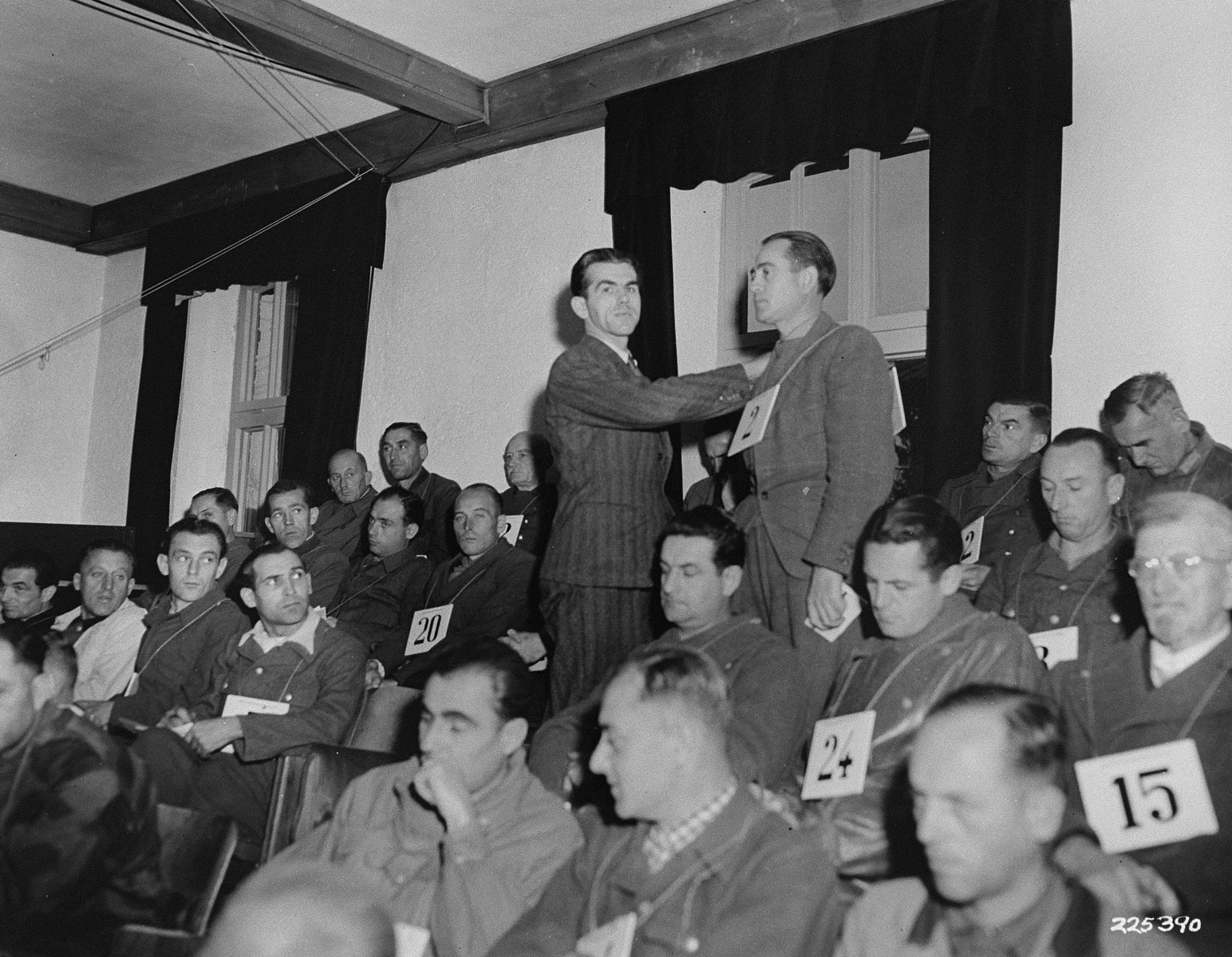 Michael Pellis, a former inmate at Dachau, identifies former SS-Obersturmfuehrer Friedrich Wilhelm Ruppert as the man responsible for selecting people to die in the crematorium, at the trial of former camp personnel and prisoners from Dachau.