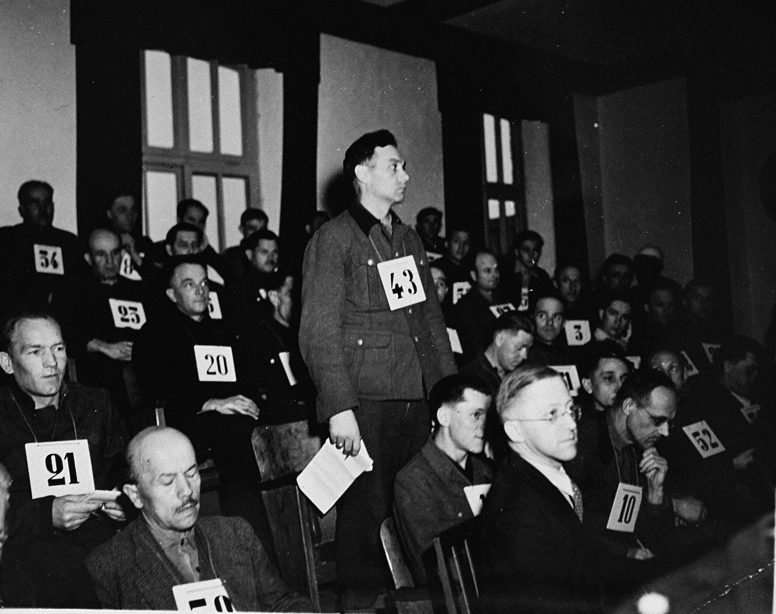 Former SS-Unterscharfuehrer Wilhelm Mueller, a defendant at the trial of 61 former camp personnel and prisoners from Mauthausen, stands in his place in the defendants' dock.    Muellert was convicted and sentenced to death on May 13, 1946.