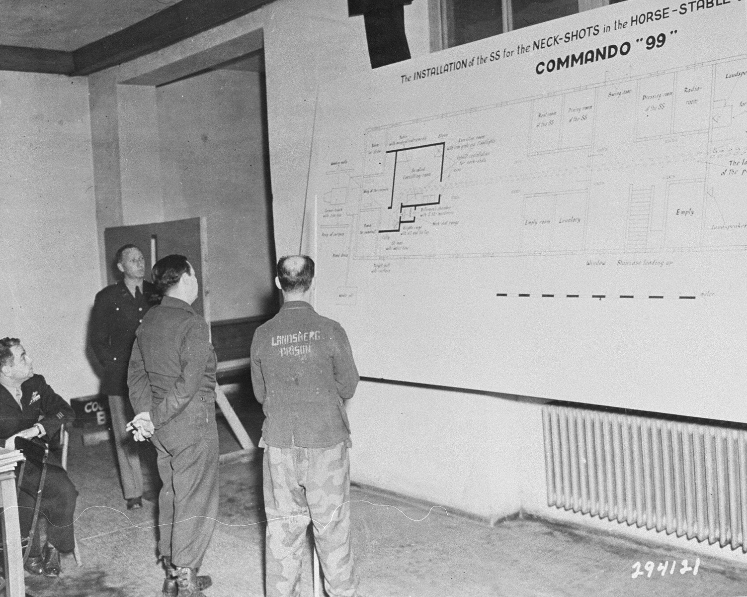 Hermann Helbig, an ethnic German from Poznan, Poland, identifies a diagram of a stable where Russian POWs were shot, during testimony he gave as a witness for the prosecution at the Buchenwald war crimes trial.