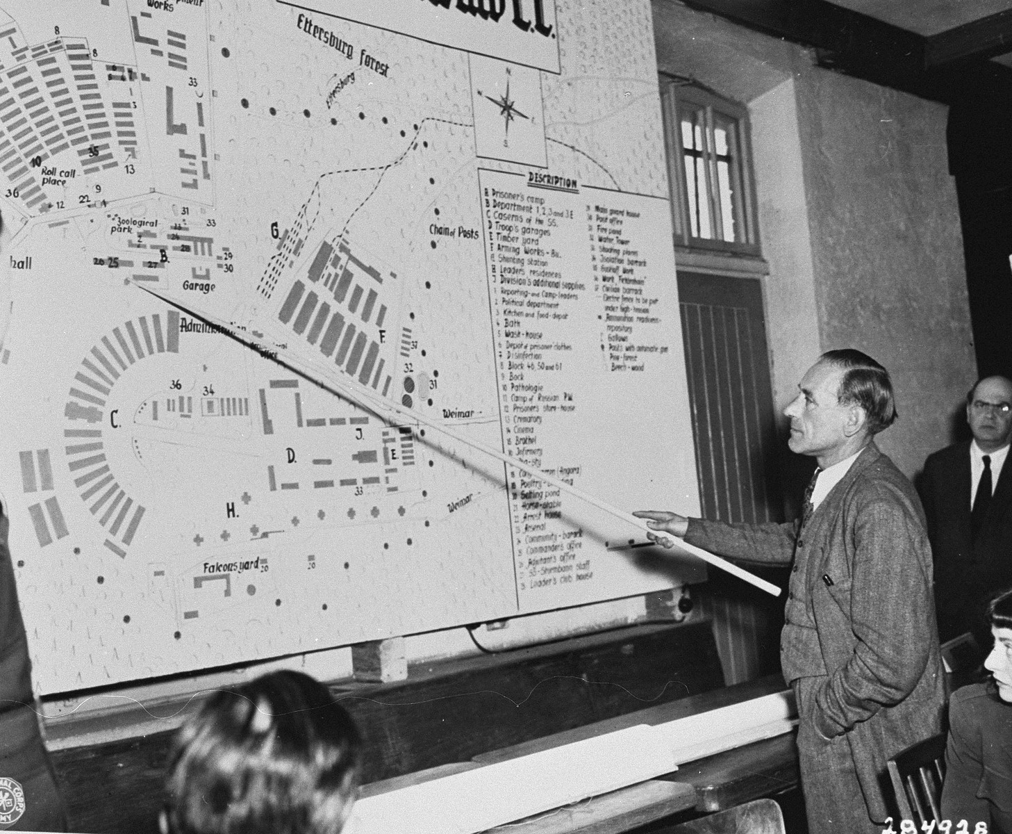 Mr. Blank, a German civilian, identifies the spot on a diagram of the camp where he saw Russian prisoners of war being taken away to be shot.  Mr Blank was a witness for the prosecution at the trial of former camp personnel and prisoners from Buchenwald.