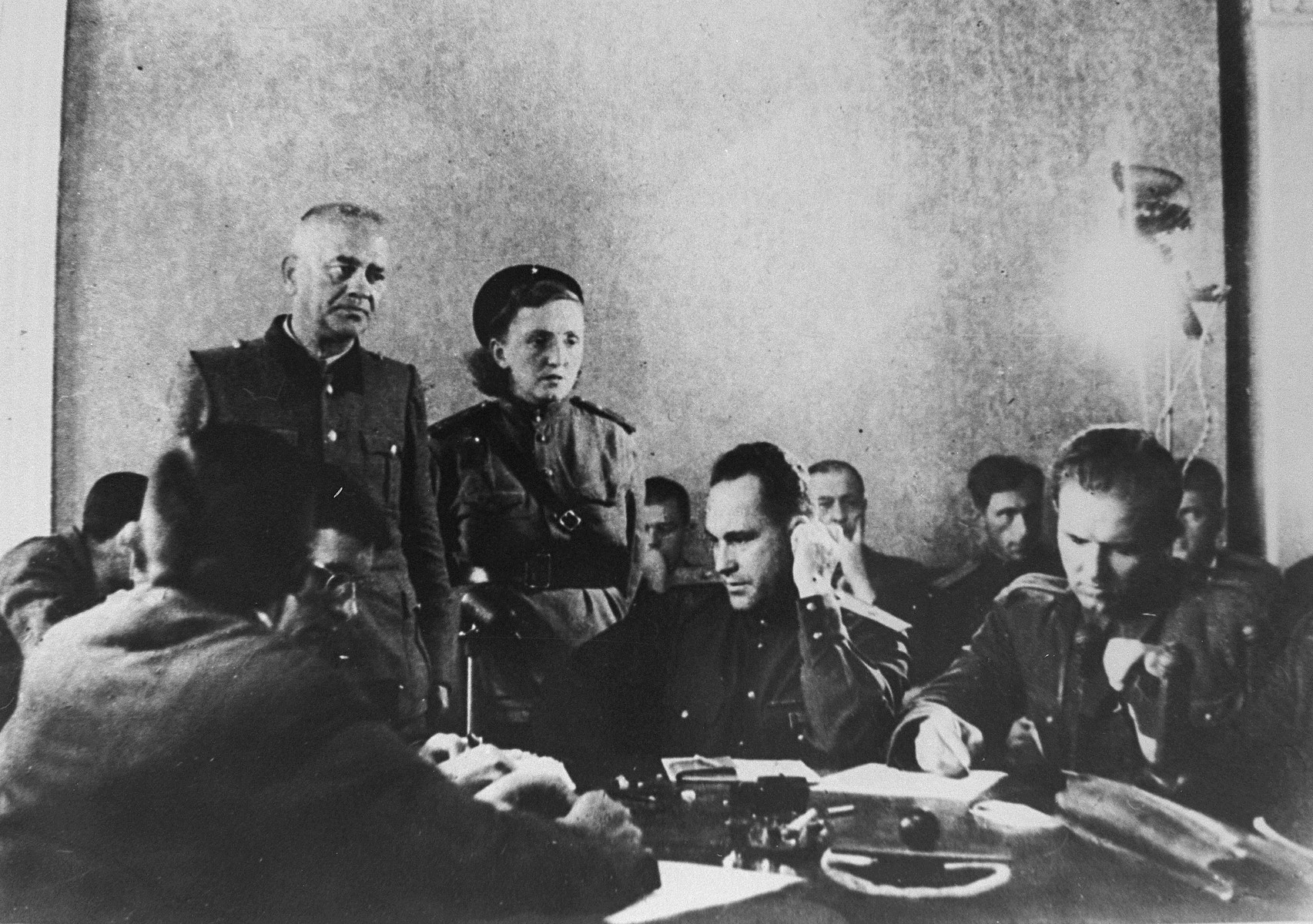 Former SS-Obersturmfuehrer (1st Lieutenant) Anton Thernes testifies to the Polish-Soviet joint commission investigating crimes in Majdanek.    Four months after the liberation of the Majdanek death camp by Soviet troops in July 1944, four former personnel and two former prisoners from the camp were brought to trial by a Polish Special Penal Court, charged with murdering and mistreating prisoners.  On 27 November, the trial began in Lublin, against a deputy chief of the camp, Anton Thernes, and his aide, Wilhelm Gerstenmeier, along with two guards, Hermann Vogel and Theodor Schoellen, and two kapos, Heinz Stalp and Edmund Pohlmann.  After Pohlmann committed suicide during the trial, only five defendants remained to be sentenced.  All five were found guilty on 2 December and executed near the crematoria in Majdanek the next day.