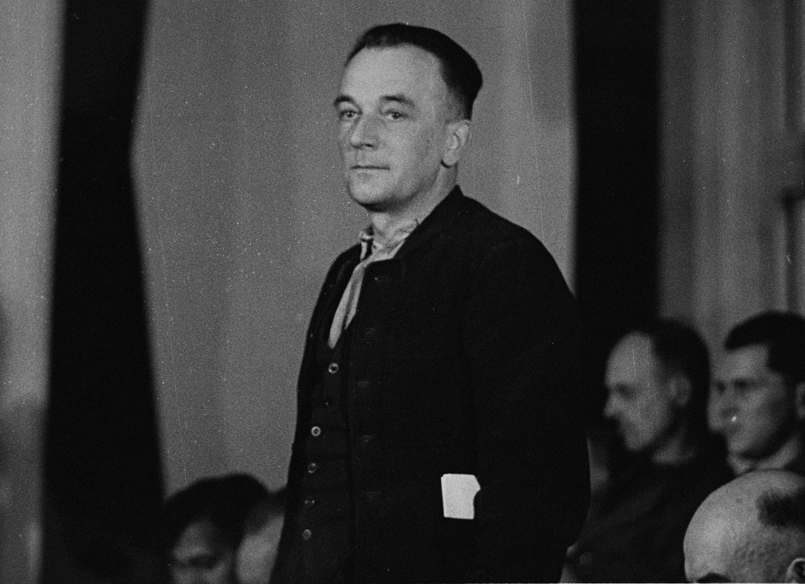Johannes Grimm stands in his place in the defendants' dock at the trial of 61 former camp personnel and prisoners from Mauthausen.