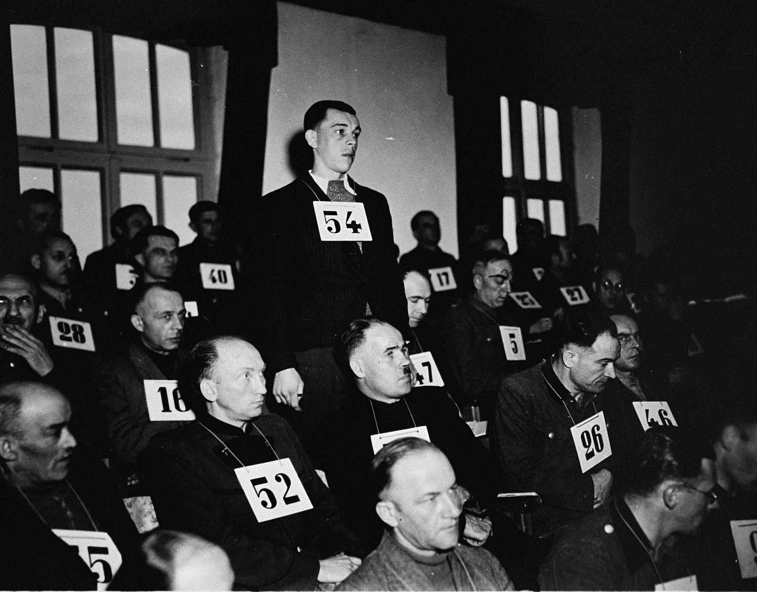 Former SS-Unterscharfuehrer Andreas Trumm, a defendant at the trial of 61 former camp personnel and prisoners from Mauthausen, stands in his place in the defendants' dock.    Trumm was convicted and sentenced to death on May 13, 1946.