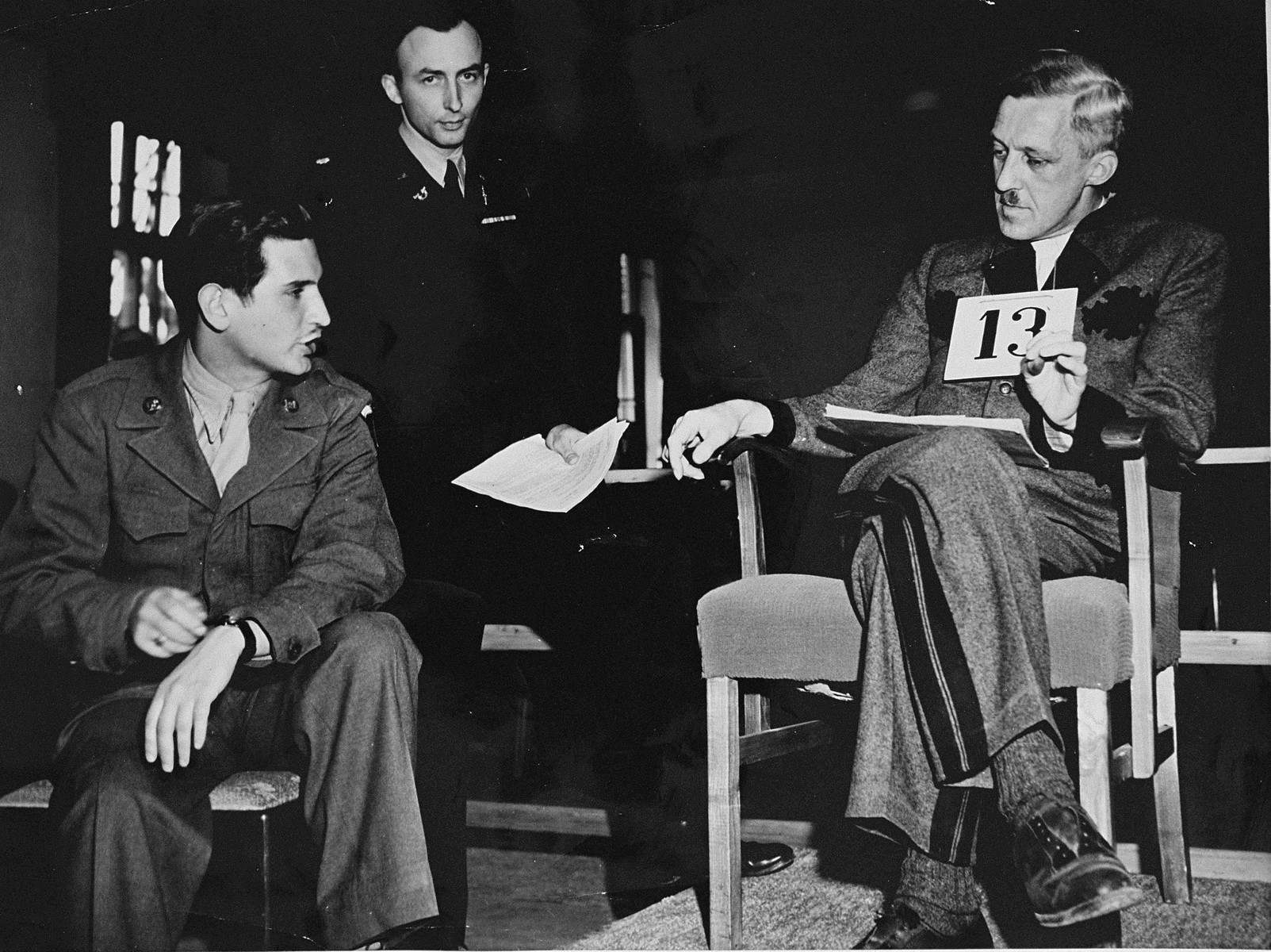 August Eigruber, former Gauleiter of Upper Austria, testifies at the trial of 61 former camp personnel and prisoners from Mauthausen.    Pictured in the middle is U.S. prosecutor William Denson.