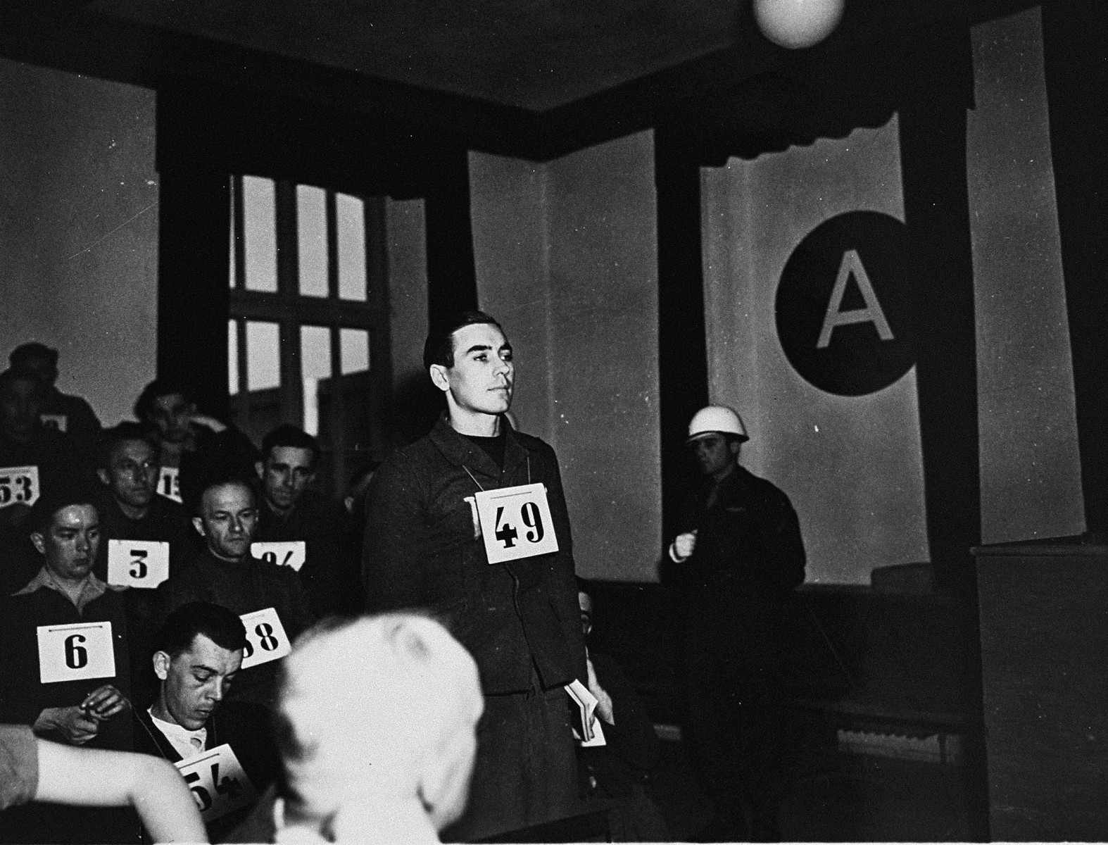 Former SS-Unterscharfuehrer Josef Riegler, a defendant at the trial of 61 former camp personnel and prisoners from Mauthausen, stands in his place in the defendants' dock.    Riegler was convicted and sentenced to death on May 13, 1946.