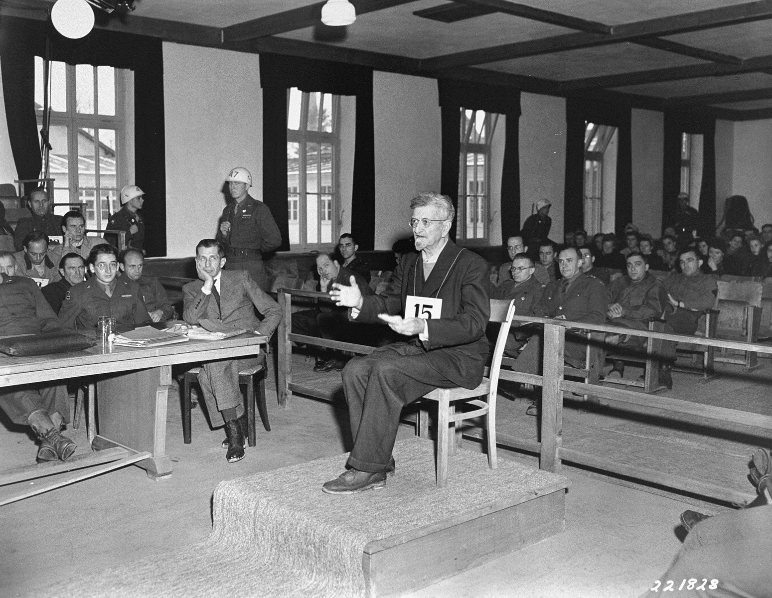 "Dr. Klaus Karl Schilling, a physician who infected over one thousand prisoners with malaria in his experiments at the Dachau camp, defends himself at the trial of former camp personnel and prisoners from Dachau.    In his appeal in English after cross examination, Schilling explained,  ""I have worked out this great labor.  It would be really a terrible loss if I could not finish this work.  I don't ask you as a court, I ask you personally to do what you can; to do what you can to help me that I may finish this report.  I need only a table and a chair and a typewriter.  It would be an enormous help for science, for my colleagues, and a good part to rehabilitate myself.""  His voice then broke and he cried."