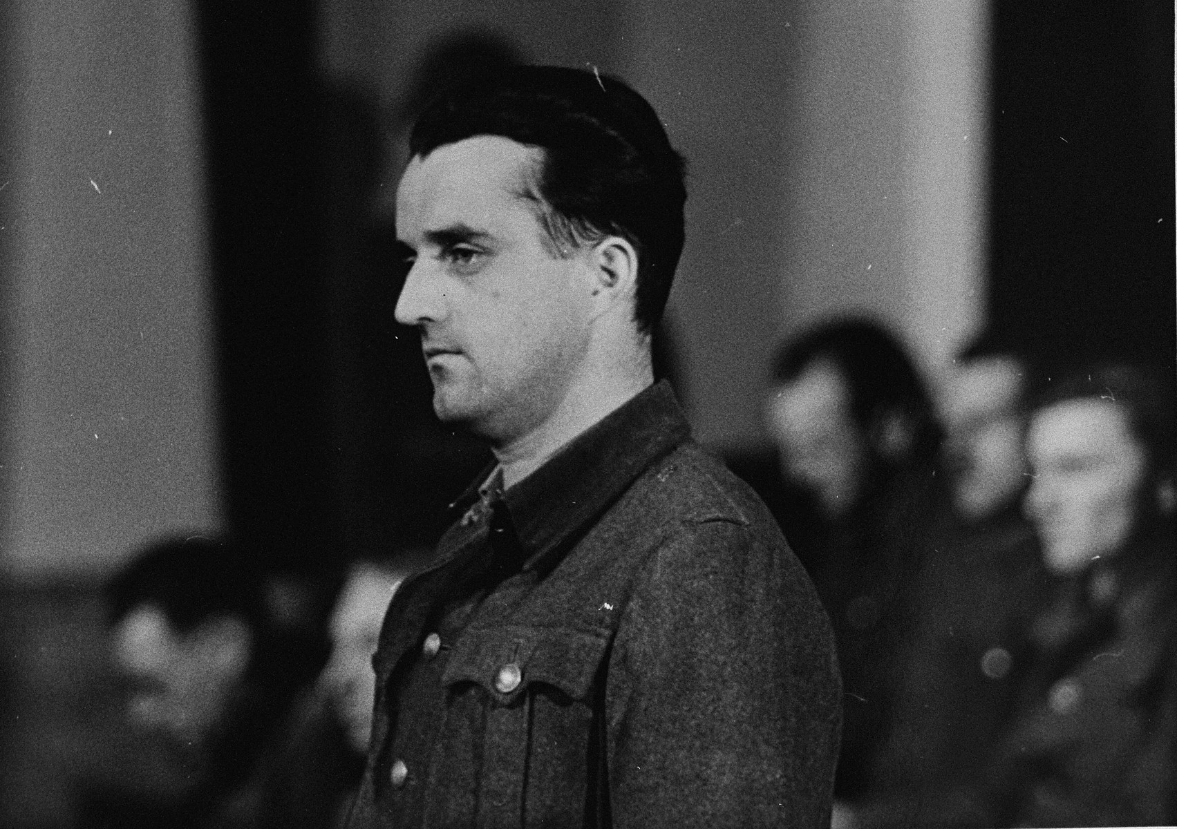An unidentified defendant at the trial of 61 former camp personnel and prisoners from Mauthausen.