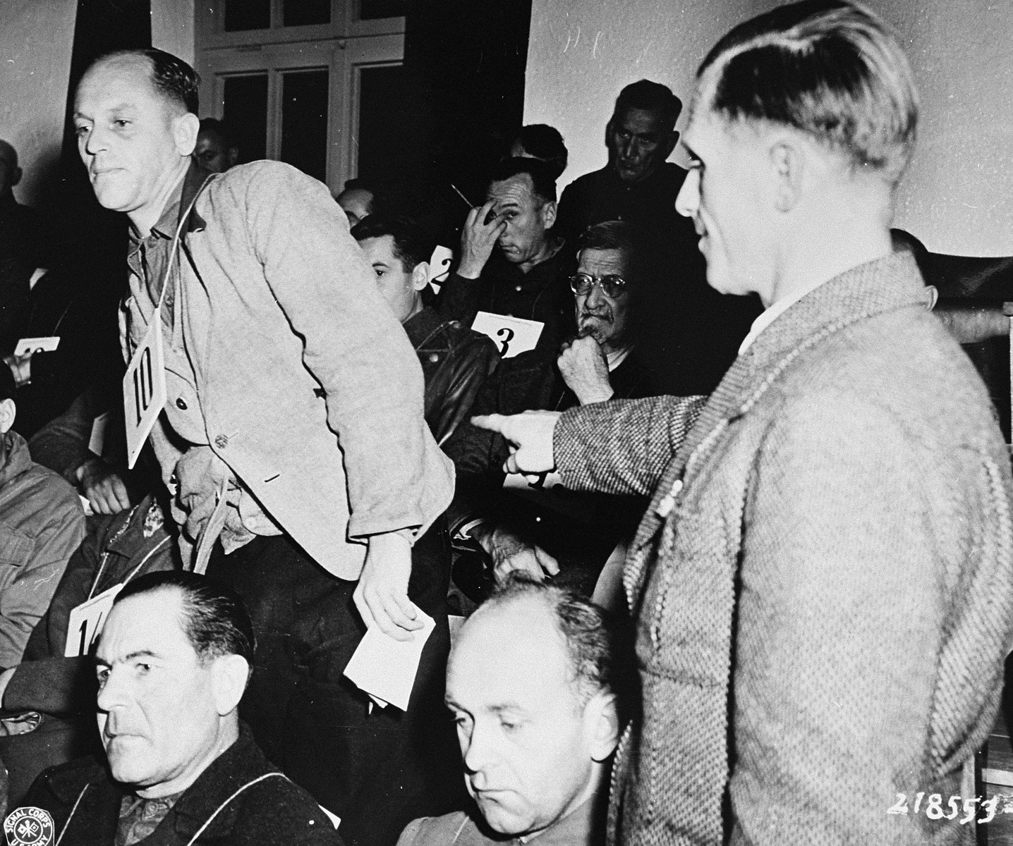 Former inmate Eugen Seybold points out Dr. Fritz Hintermayer as the man present at the mass execution of 95 high-ranking Russian officers held as prisoners of war, during the trial of former camp personnel and prisoners from Dachau.