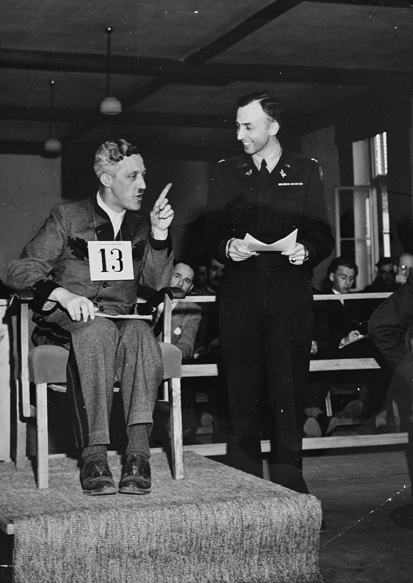 August Eigruber, former Gauleiter of Upper Austria, testifies at the trial of 61 former camp personnel and prisoners from Mauthausen.    Pictured at the right is U.S. prosecutor William Denson.