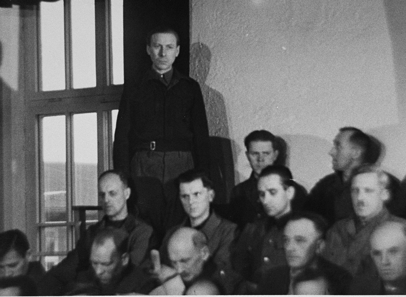 Hans Altfuldisch, stands in his place in the defendant's dock, at the trial of 61 former camp personnel and prisoners from Mauthausen.
