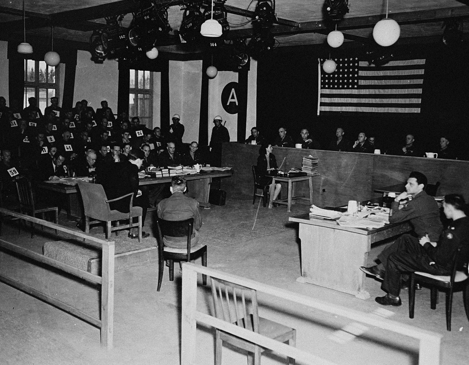 The tribunal hears the testimony of a witness at the trial of 61 former camp personnel and prisoners from Mauthausen.