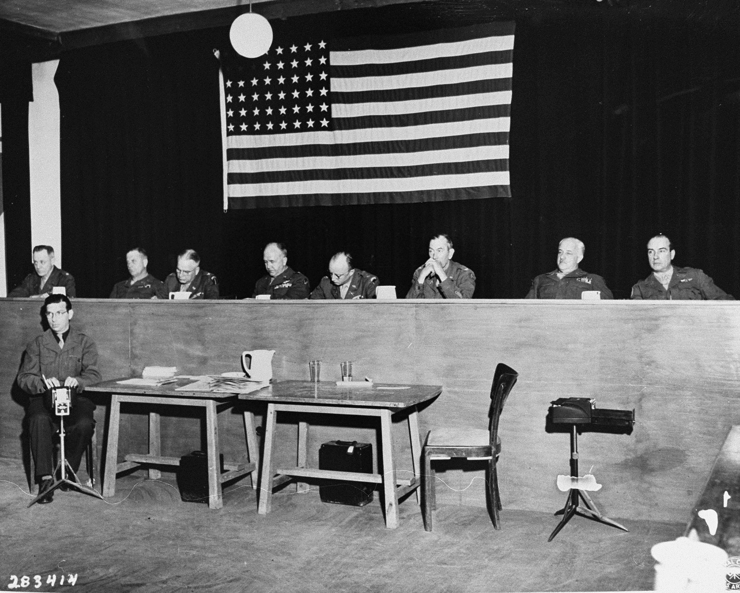The eight American officers of the U.S. military tribunal at the trial of former camp personnel and prisoners from Buchenwald.    The court personnel pictured from left to right are Lt. Col. Morris, Col. Robertson, Col. Ackerman, Brig. Gen. Kiel, Lt. Col. Dwinell, Col. Pierce, Col. Dunnning, and Lt. Col. Walker.